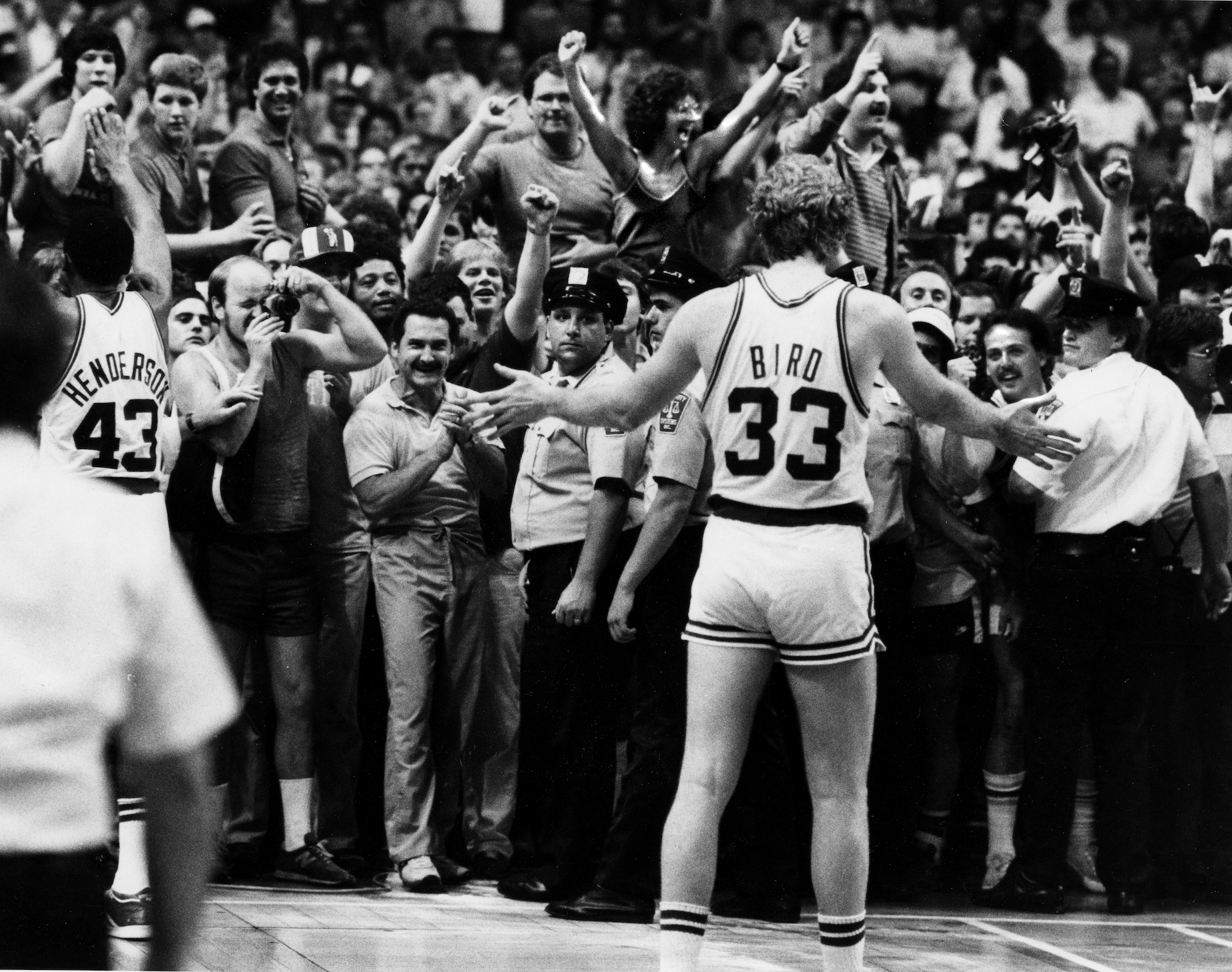 Boston Celtics star Larry Bird gestures to the crowd in 1984