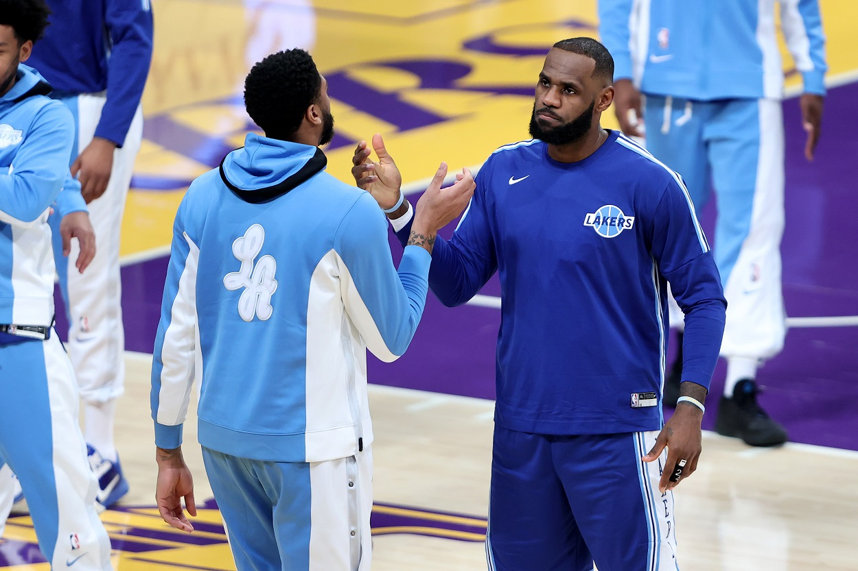 Lakers' LeBron James and Anthony Davis shake hands before an NBA game.