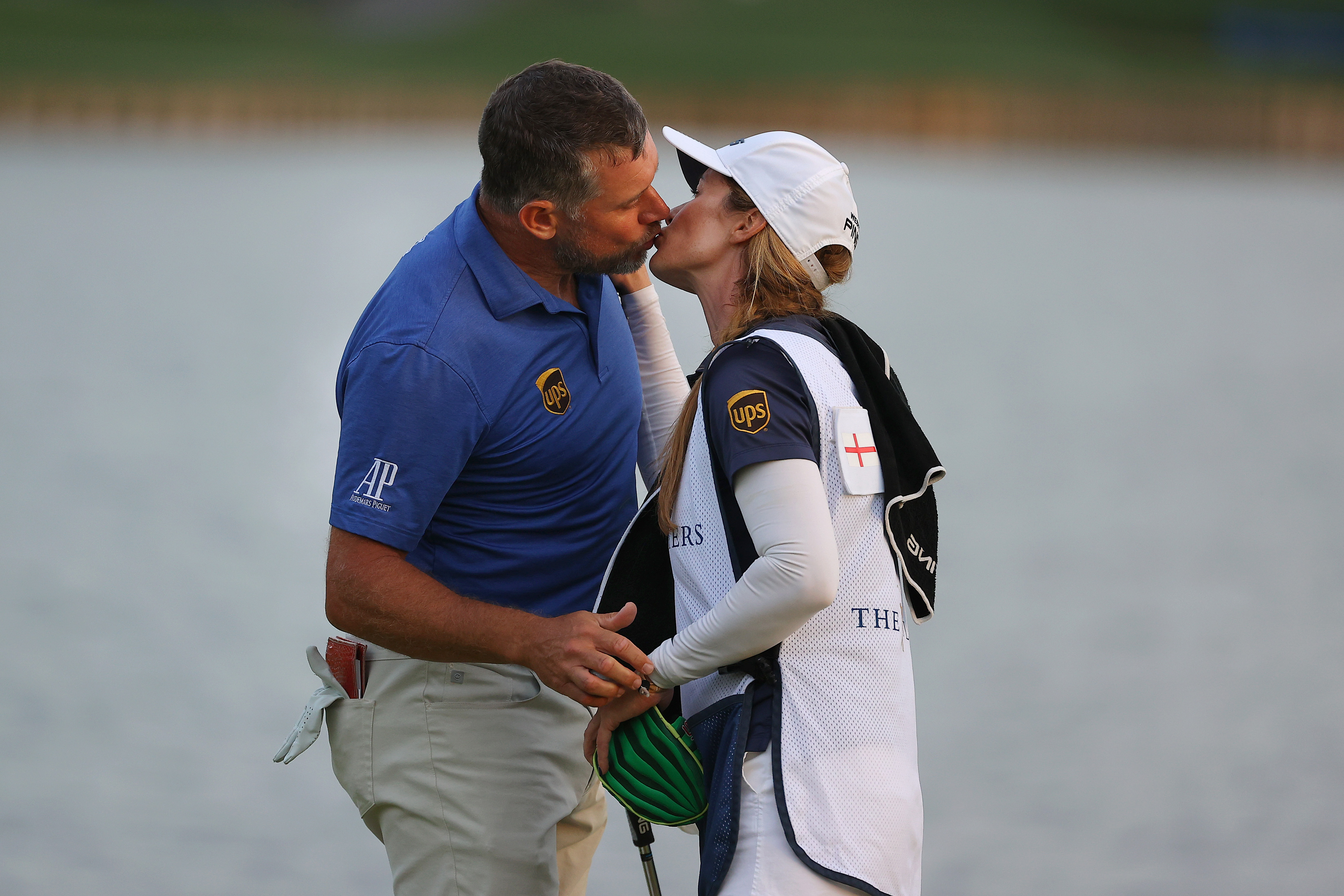 Lee Westwood kisses his caddie and partner Helen Storey after the 2021 PLAYERS Championship