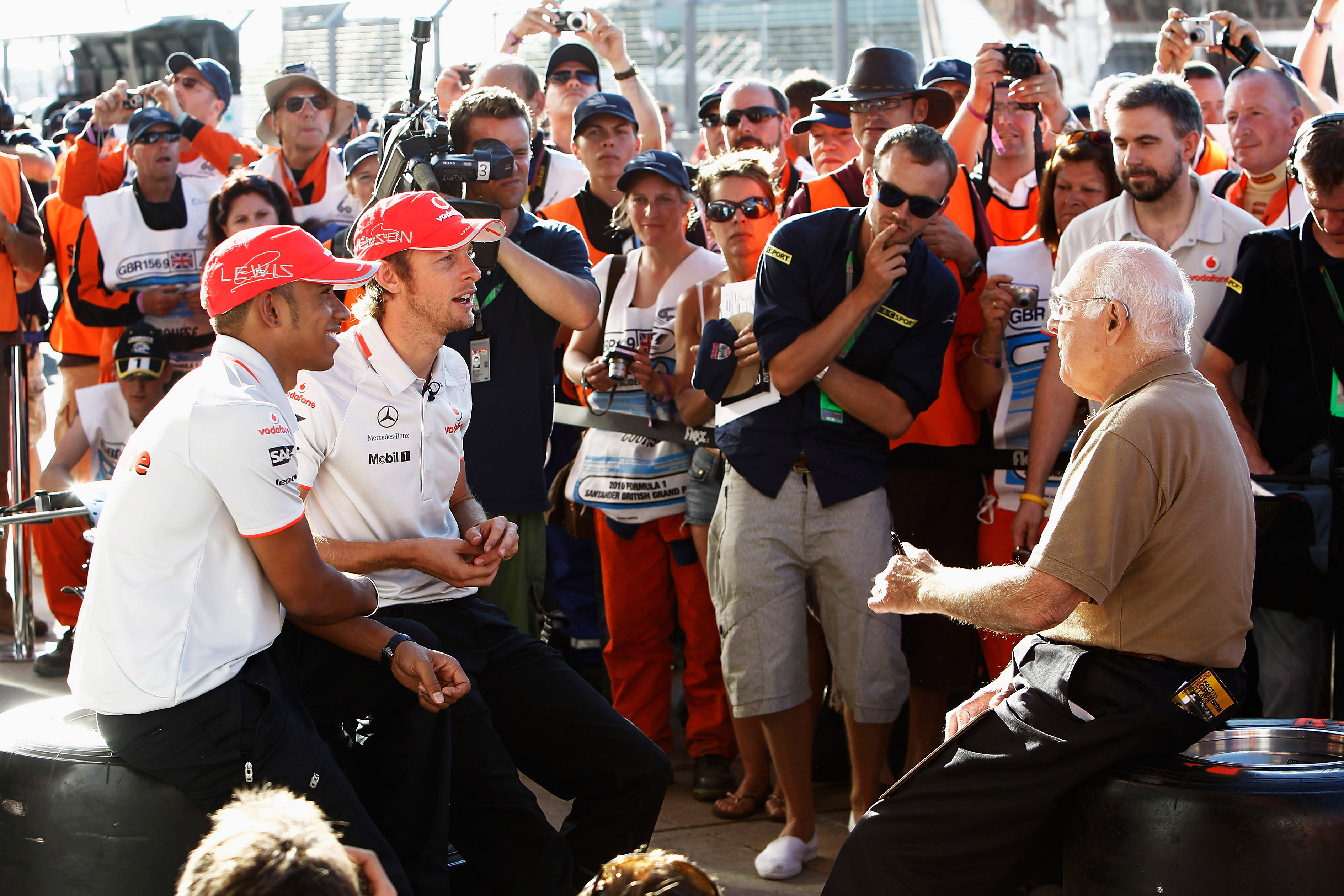 Lewis Hamilton and Jenson Button are interviewed by Murray Walker in 2010