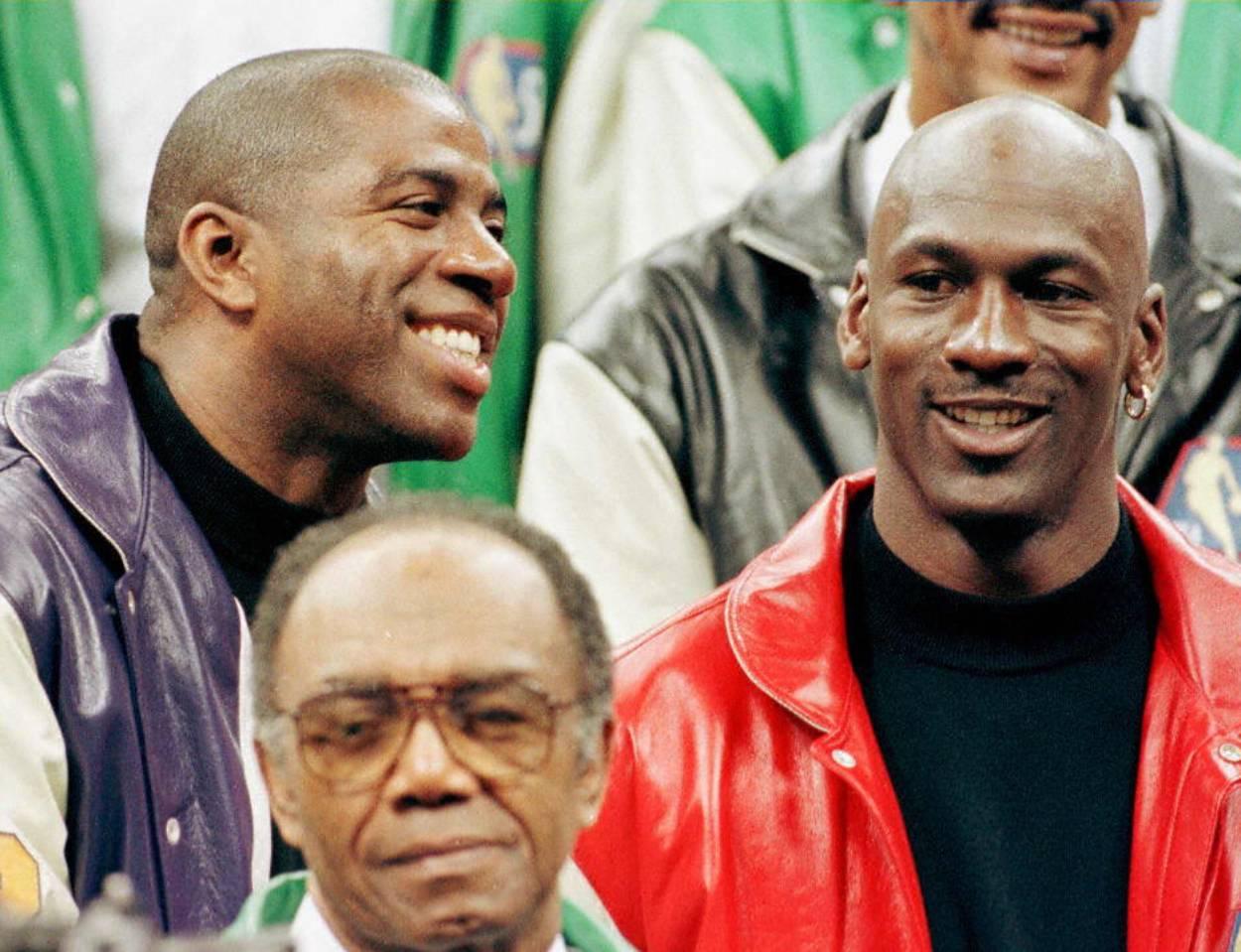 NBA legends Magic Johnson (L) and Michael Jordan.