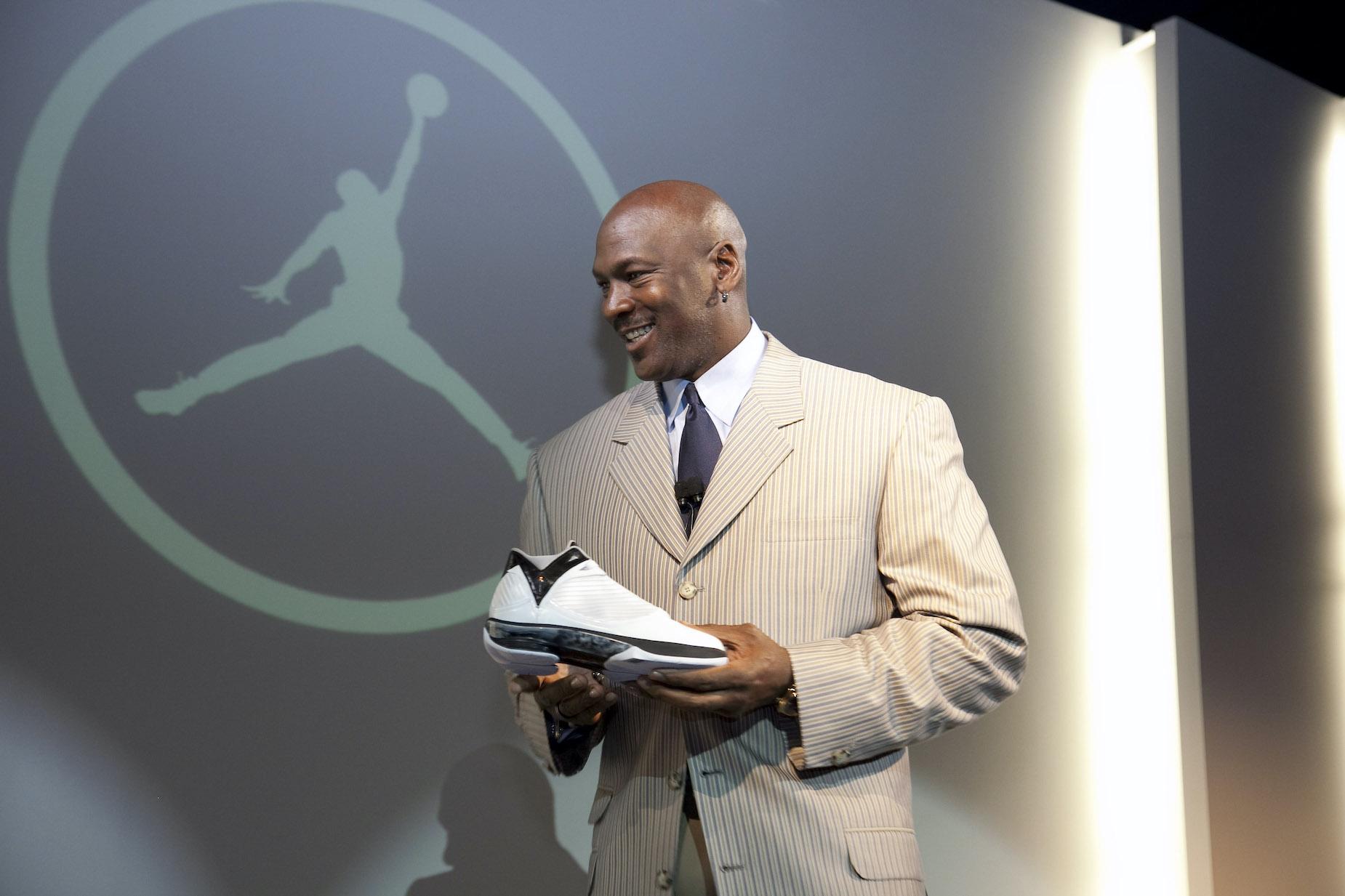 Michael Jordan holds an Air Jordan shoe during a 2009 media event.
