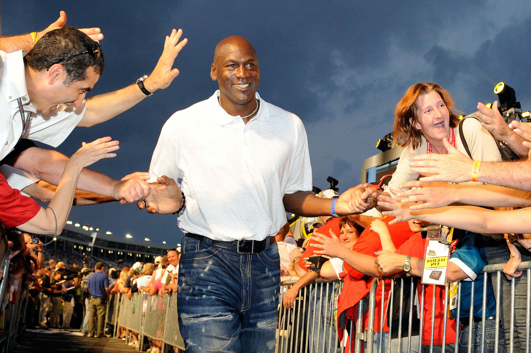 Michael Jordan high fives his fans at a 2010 NASCAR race.