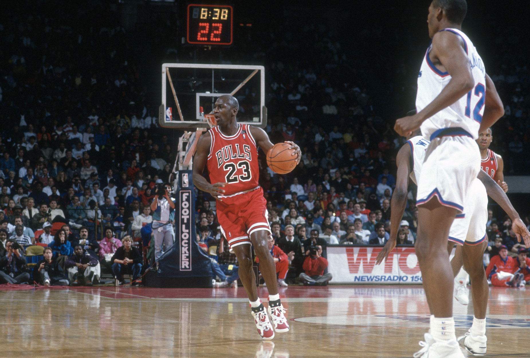 Michael Jordan dribbles down the court during a Chicago Bulls game.