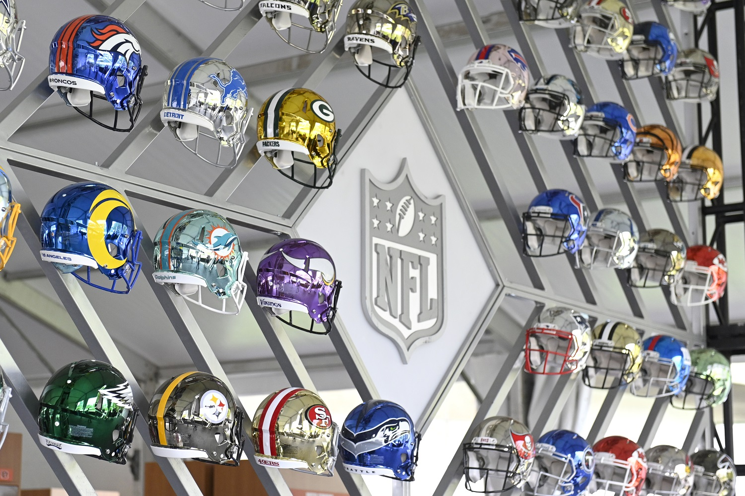The Wall of NFL team helmets on display inside the NFL Draft Experience in Cleveland. | Duane Prokop/Getty Images