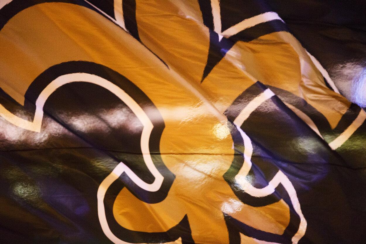 A flag depicting the New Orleans Saints logo.