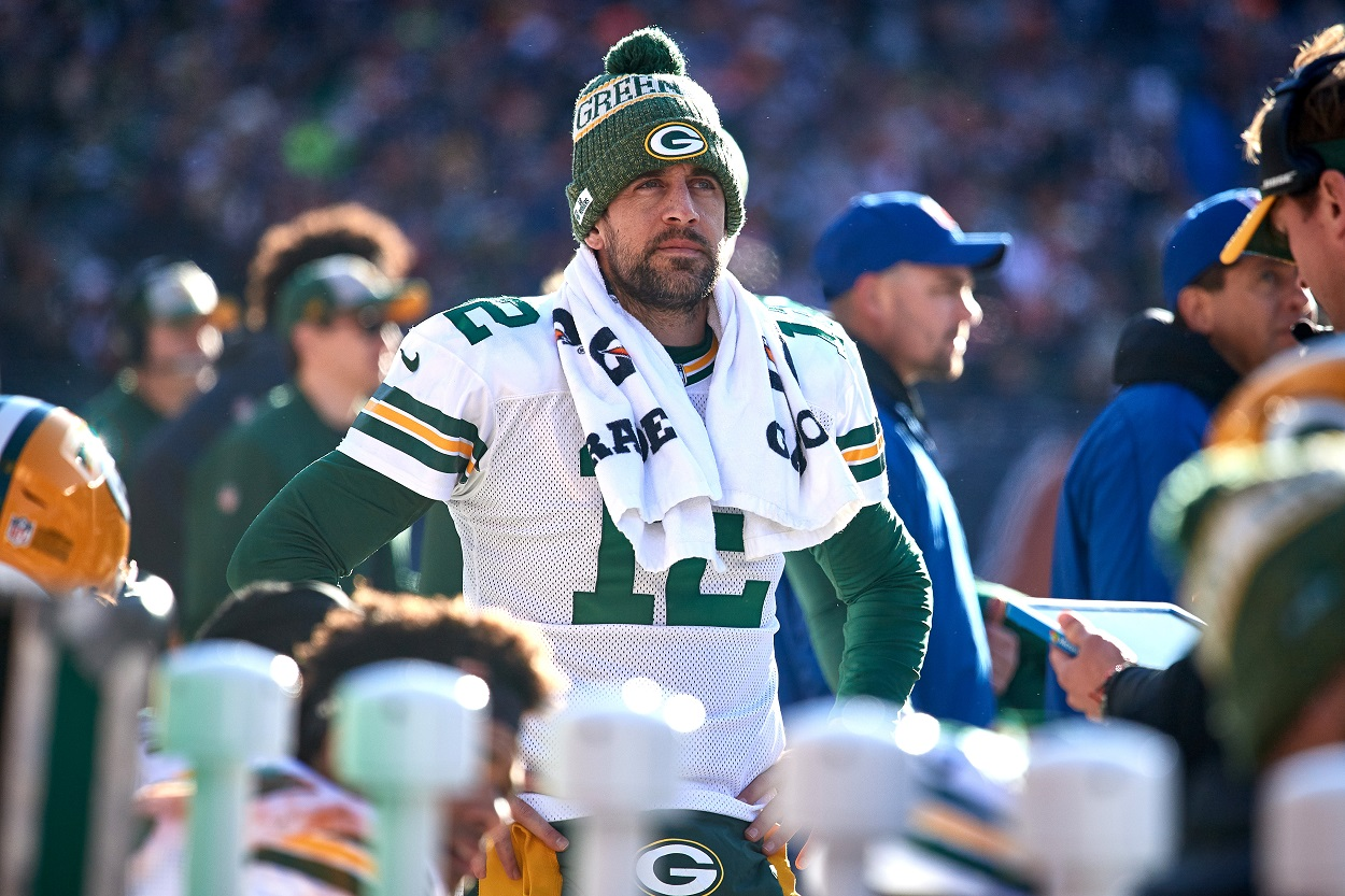 Packers star quarterback Aaron Rodgers roams the sidelines during an NFL game.