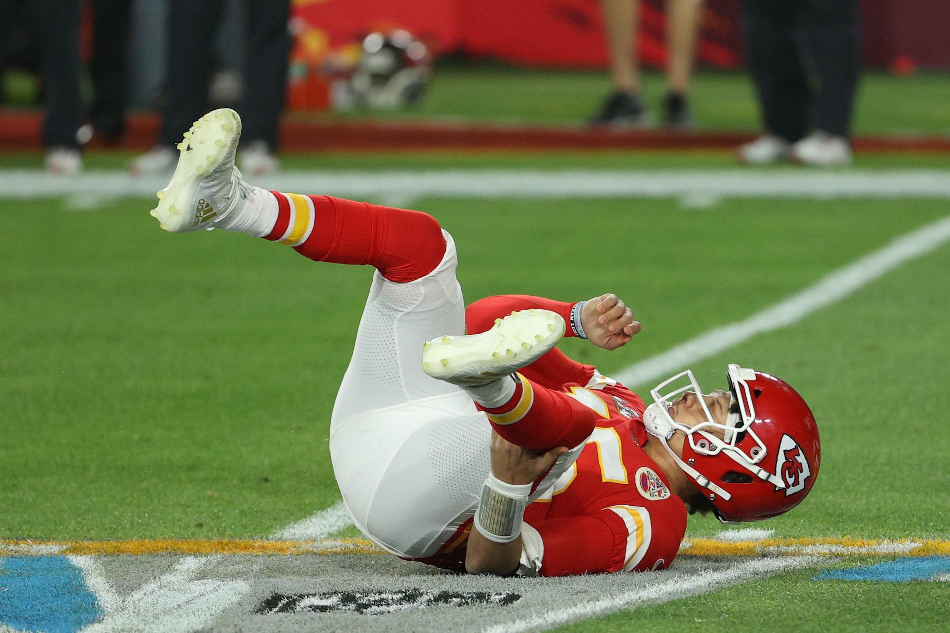 Kansas City Chiefs quarterback Patrick Mahomes lies on the turf during Super Bowl 55.