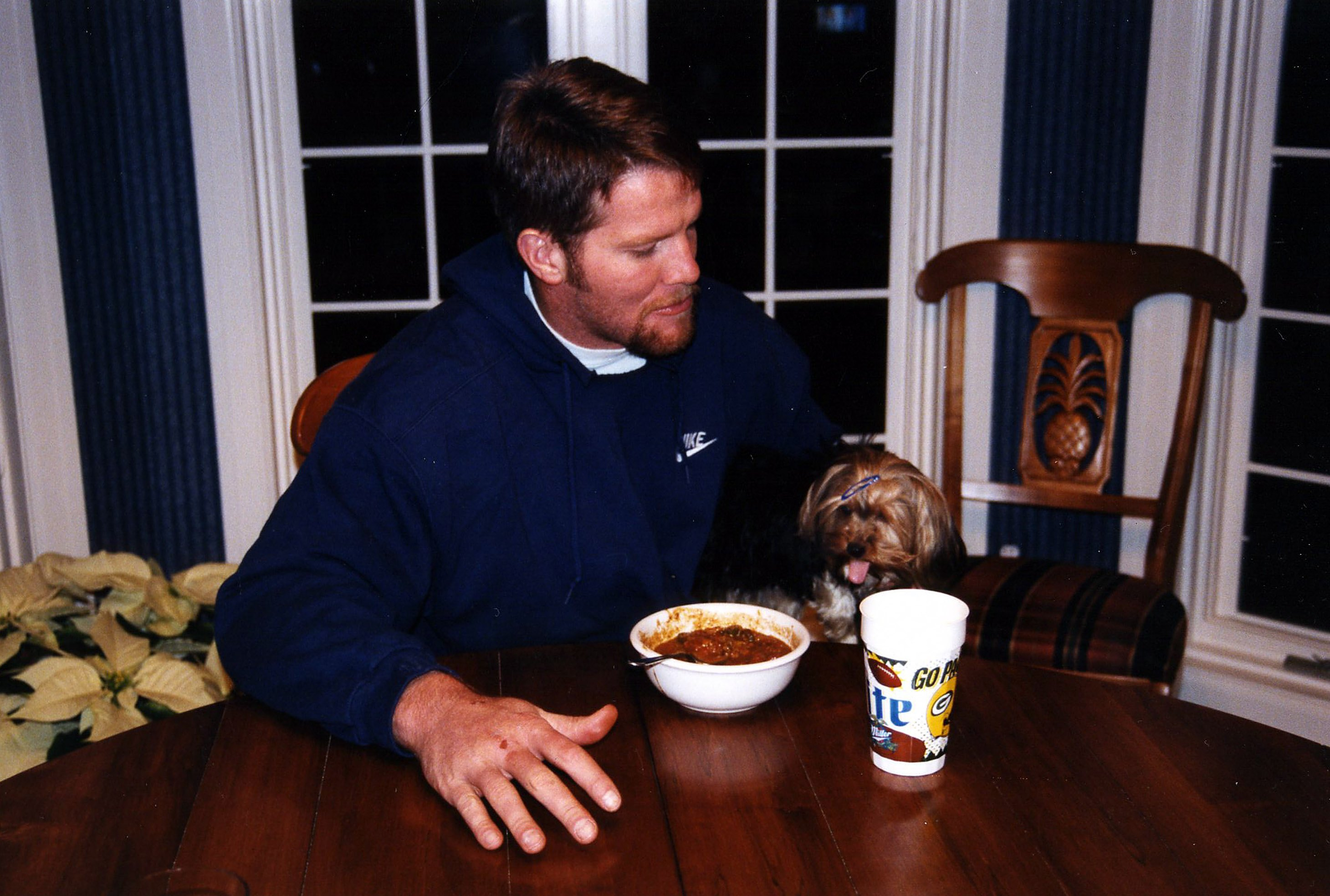 Quarterback Brett Favre with his dog Jaz at his home in Green Bay, Wisconson in 1998