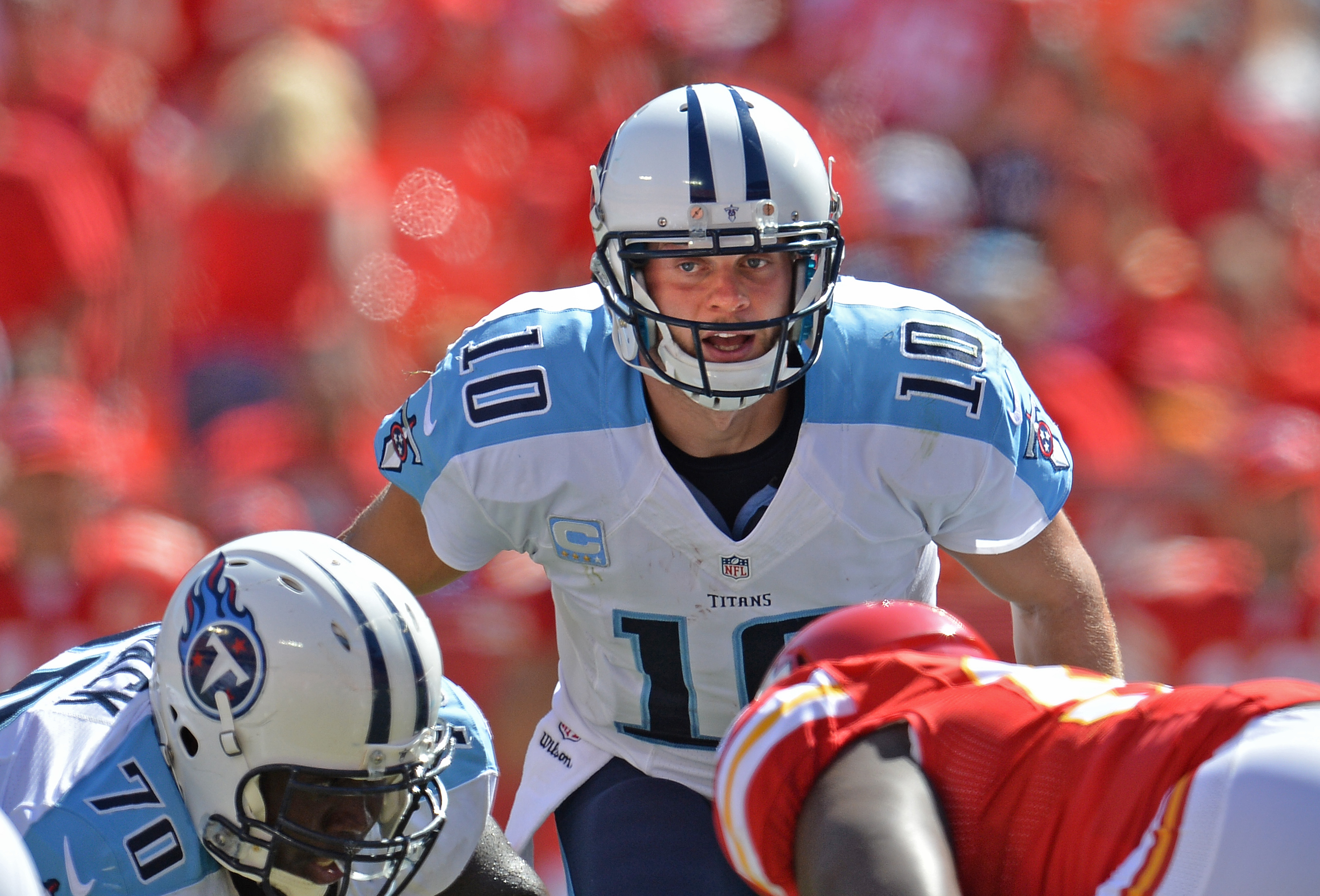 Quarterback Jake Locker of the Tennessee Titans calls out a play