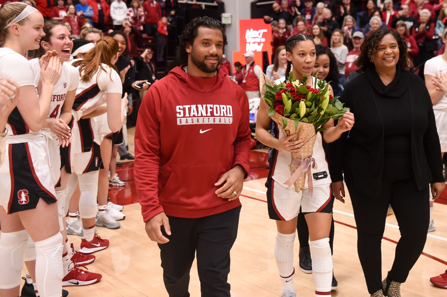 Seattle Seahawks quarterback Russell Wilson walks next to his sister, Anna Wilson, and their mother, Tammy Wilson, to celebrate senior day at Stanford.