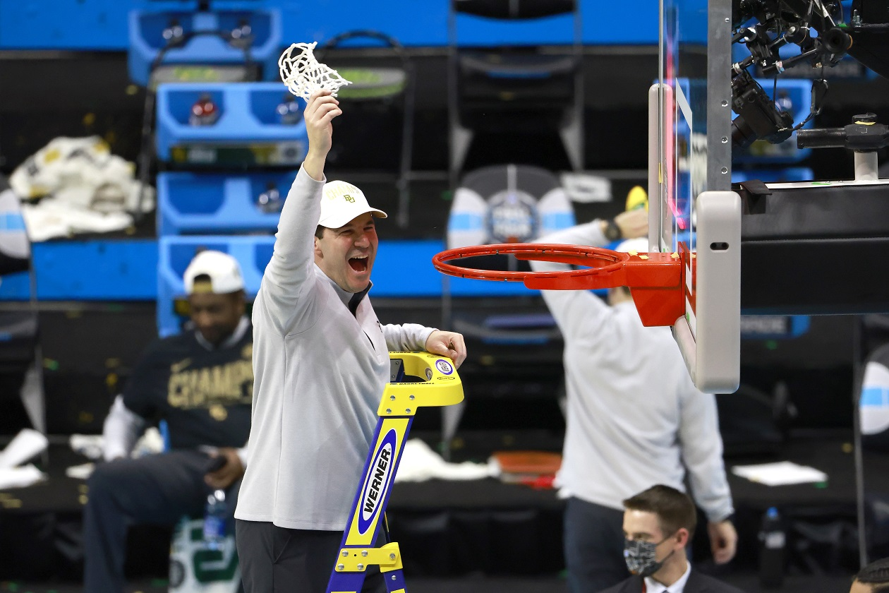 Baylor head coach Scott Drew cuts down the net after winning the national championship