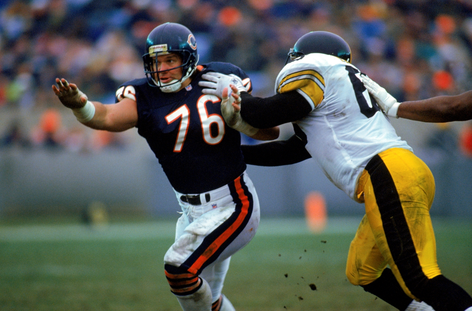 Chicago Bears defensive lineman Steve McMichael runs past a Pittsburgh Steelers player.