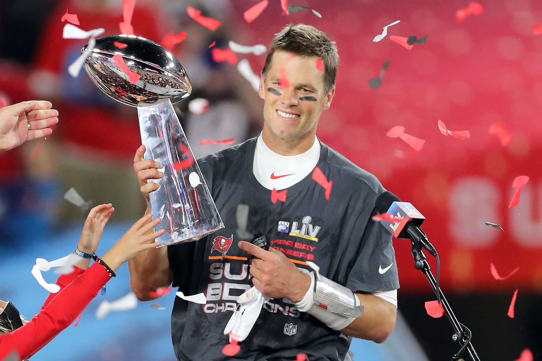 Tampa Bay Buccaneers quarterback Tom Brady lifts the Lombardi Trophy after victory in Super Bowl 55