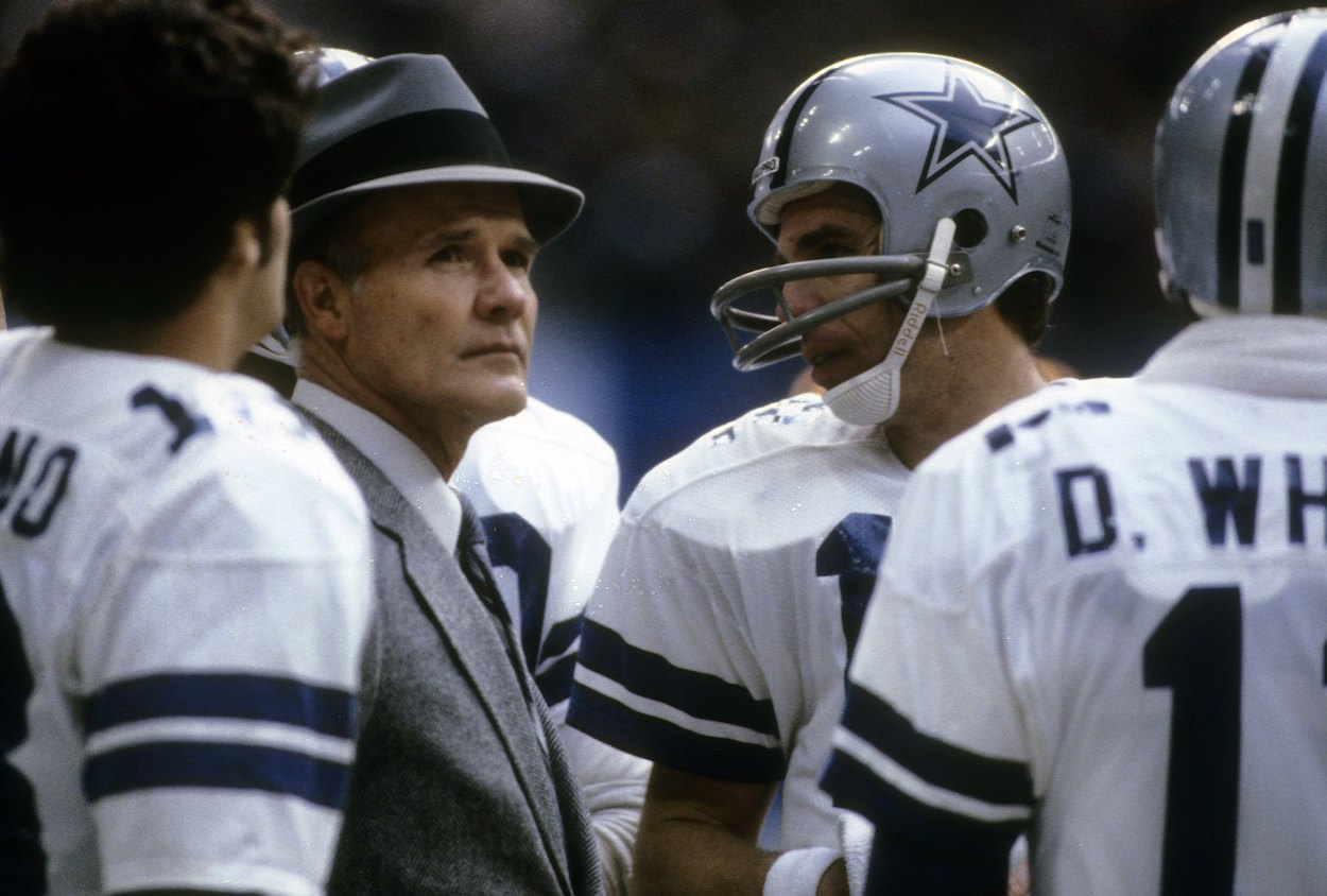 Tom Landry talks with Roger Staubach and Danny White