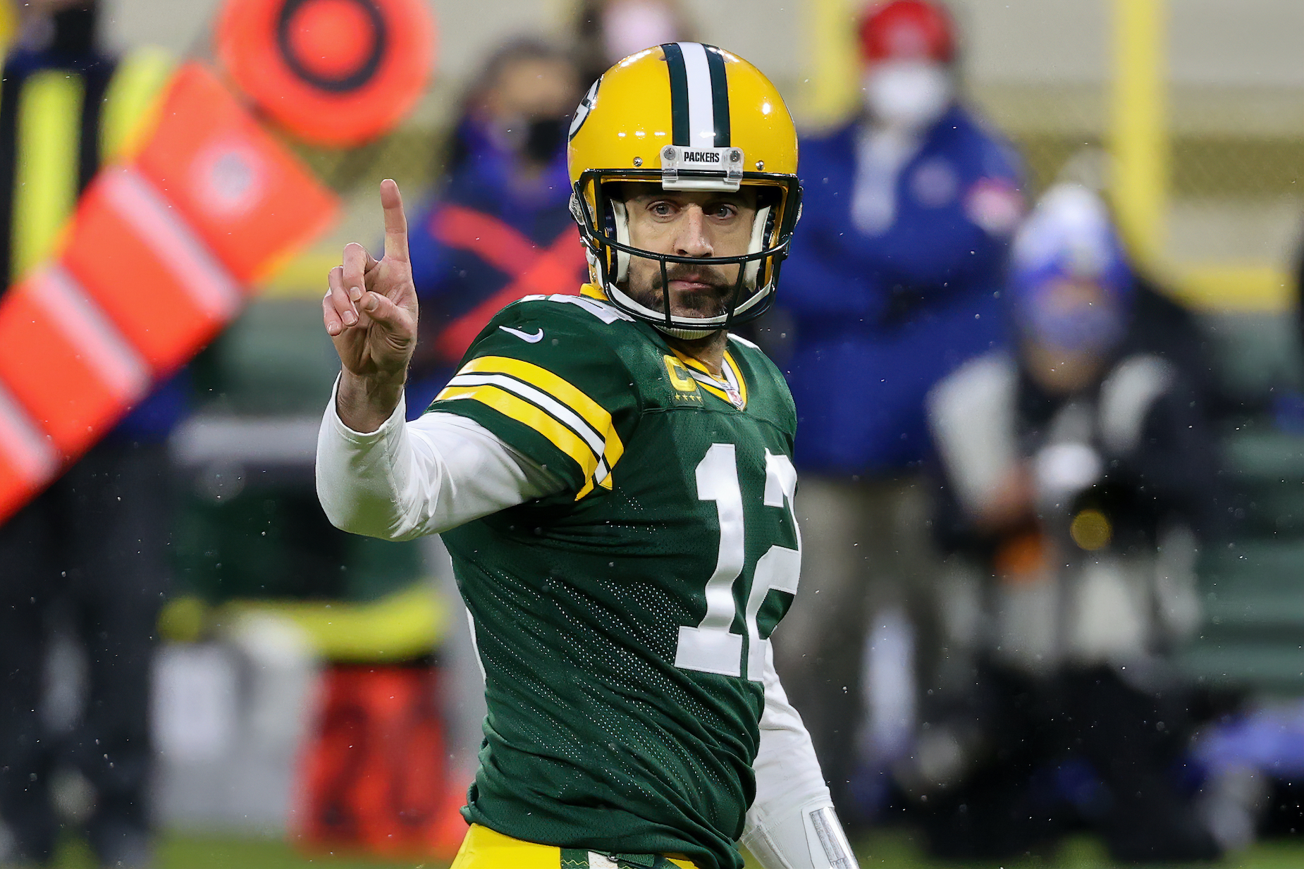 Green Bay Packers quarterback Aaron Rodgers holds up a single finger during the 2020 NFL playoffs.