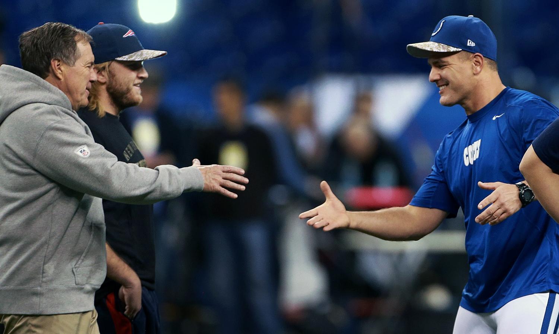 Patriots head coach Bill Belichick shakes hands with Colts kicker Adam Vinatieri before a game.