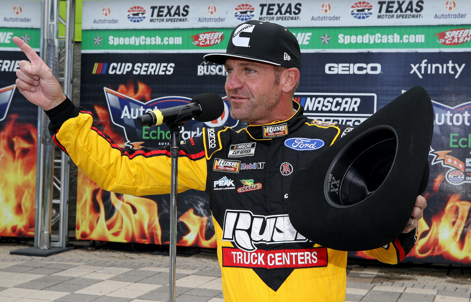 Clint Bowyer speaks to the crowd at the end of his NASCAR career.