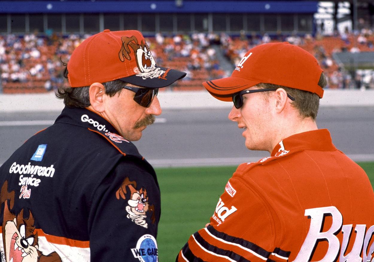 Dale Earnhardt Sr. and Dale Earnhardt Jr. talk ahead of a NASCAR Cup Series race