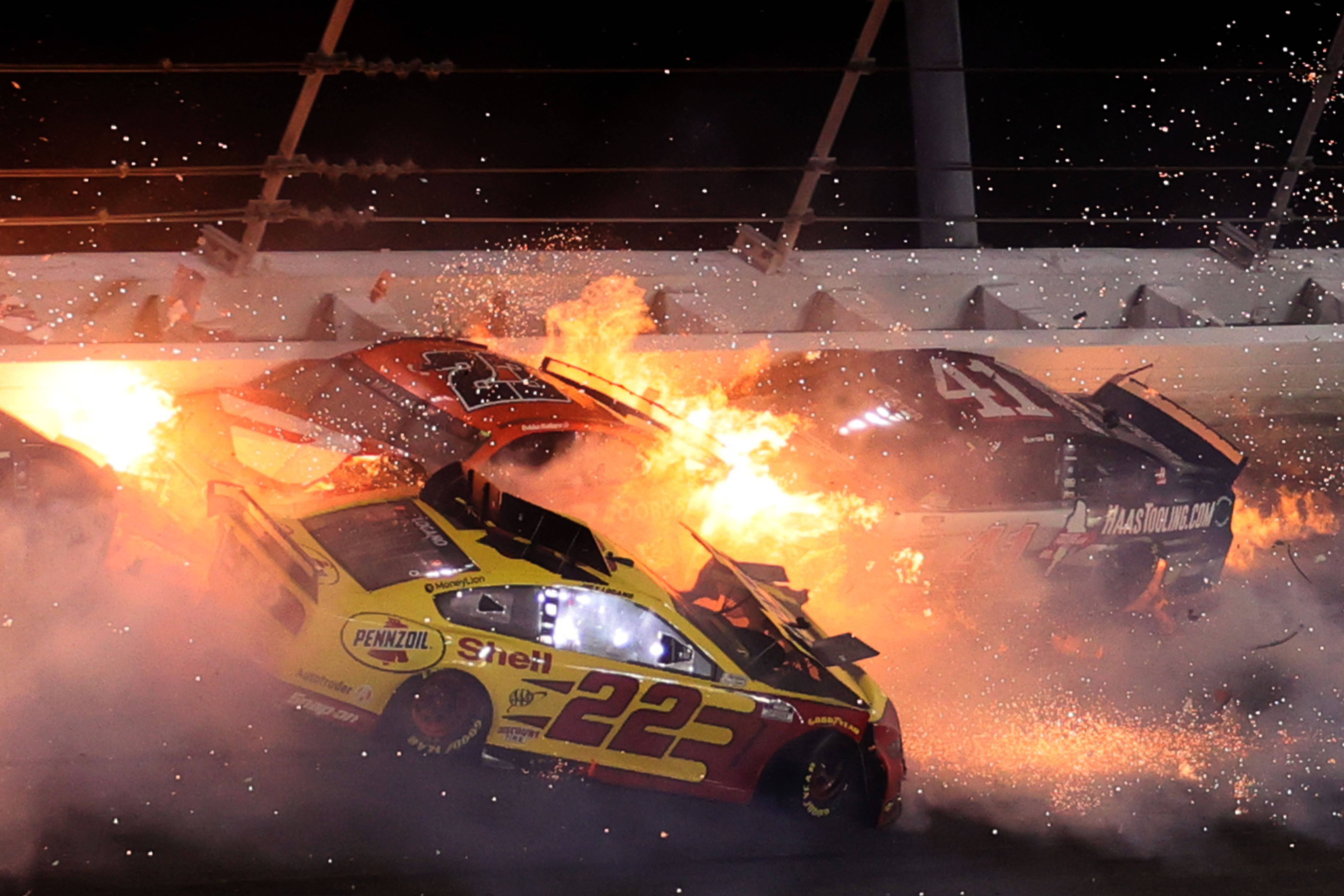 Joey Logano, driver of the #22 Shell Pennzoil Ford, Bubba Wallace, driver of the #23 DoorDash Toyota, and Cole Custer, driver of the #41 HaasTooling.com Ford, are involved in an on-track incident during the NASCAR Cup Series Daytona 500 at Daytona International Speedway in 2021