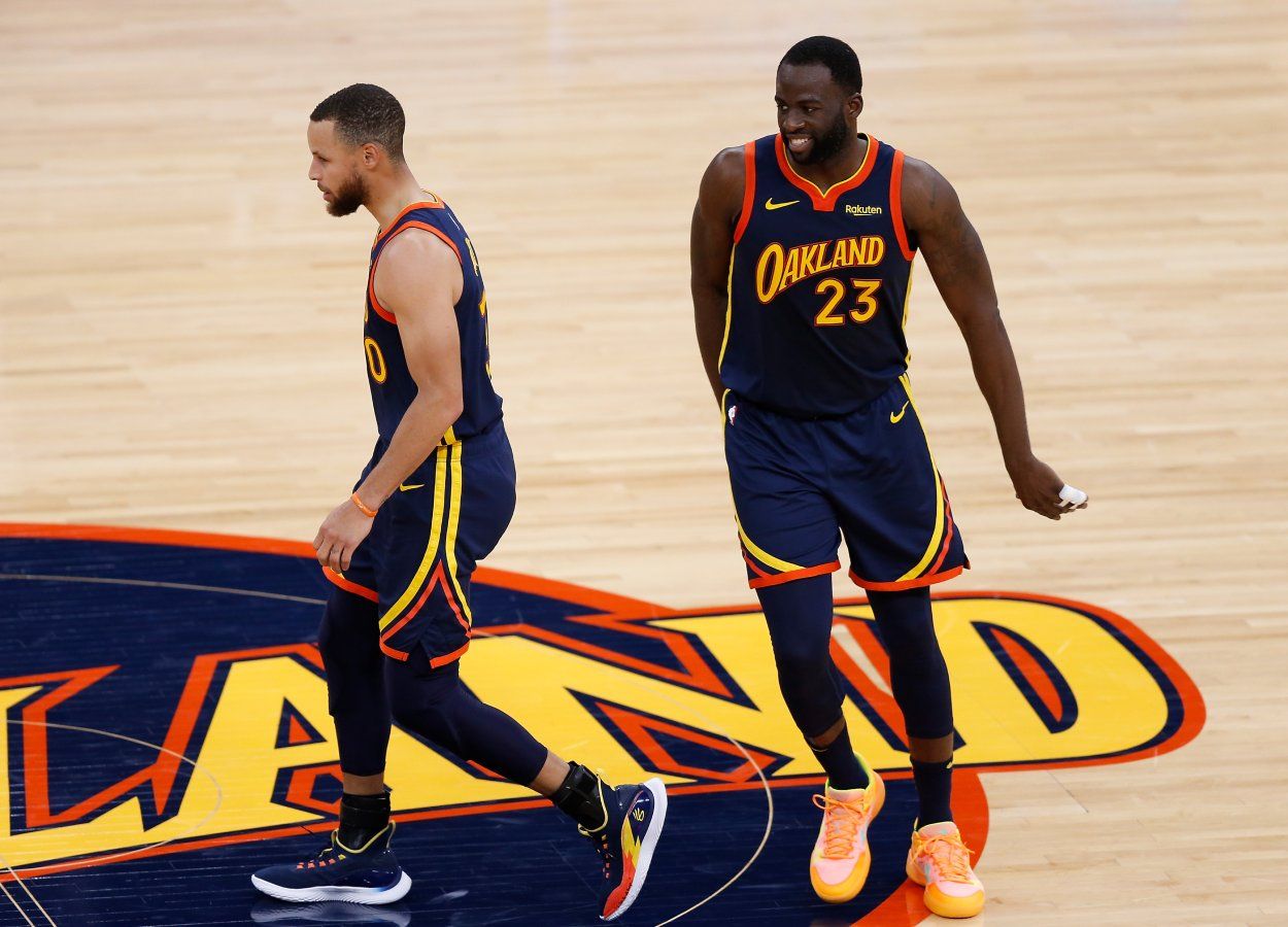 Golden State Warriors teammates Draymond Green and Stephen Curry in May 2021.