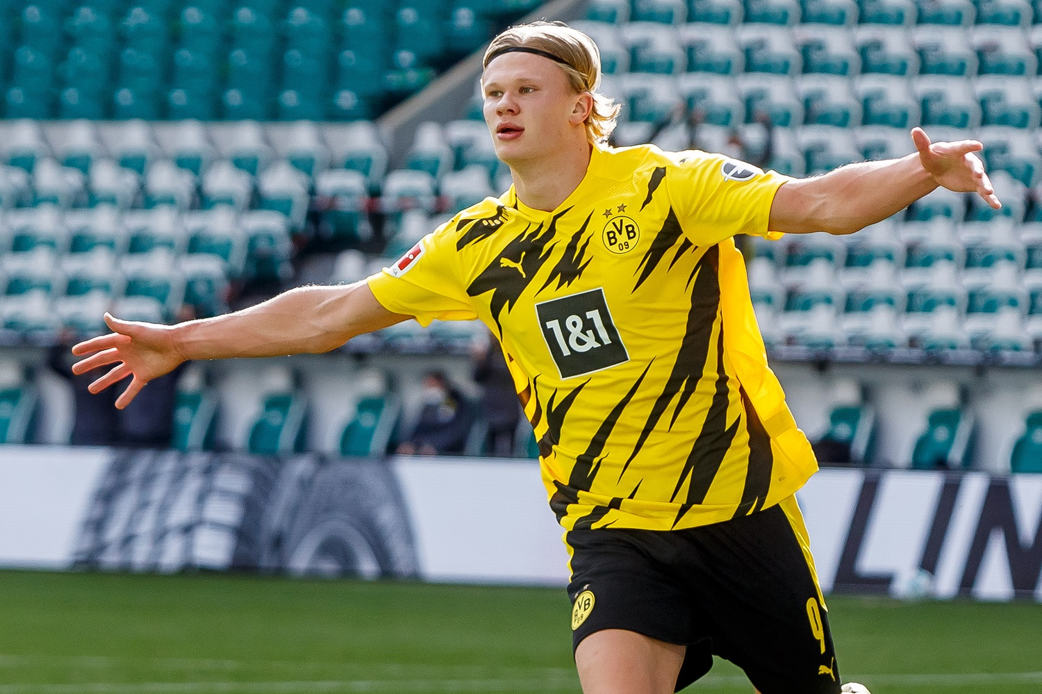Erling Haaland of Borussia Dortmund celebrates after scoring his team's second goal during the Bundesliga match between vs. VfL Wolfsburg on April 24, 2021.