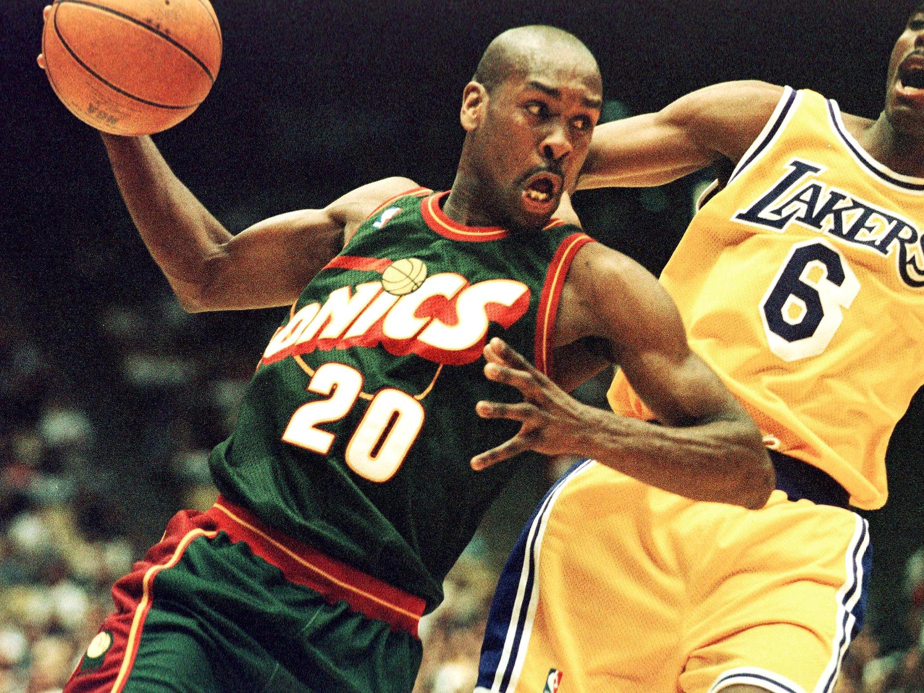 Gary Payton dribbles the ball as a member of the Seattle SuperSonics.
