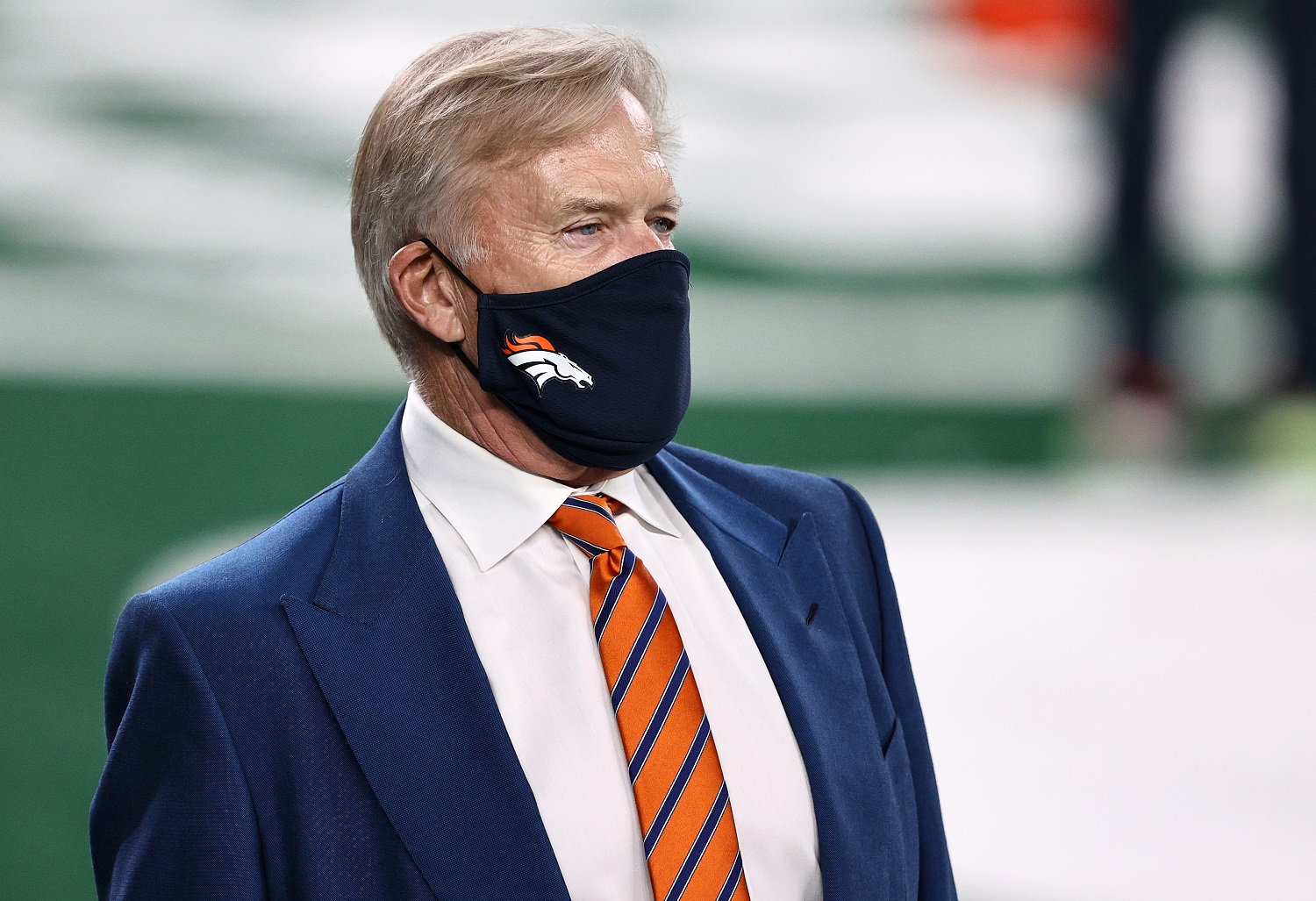 Denver Broncos quarterback-turned-executive John Elway admits to hanging up the phone on the league office after learning his team would have to play a game as scheduled without any of its quarterbacks.   Photo by Elsa/Getty Images