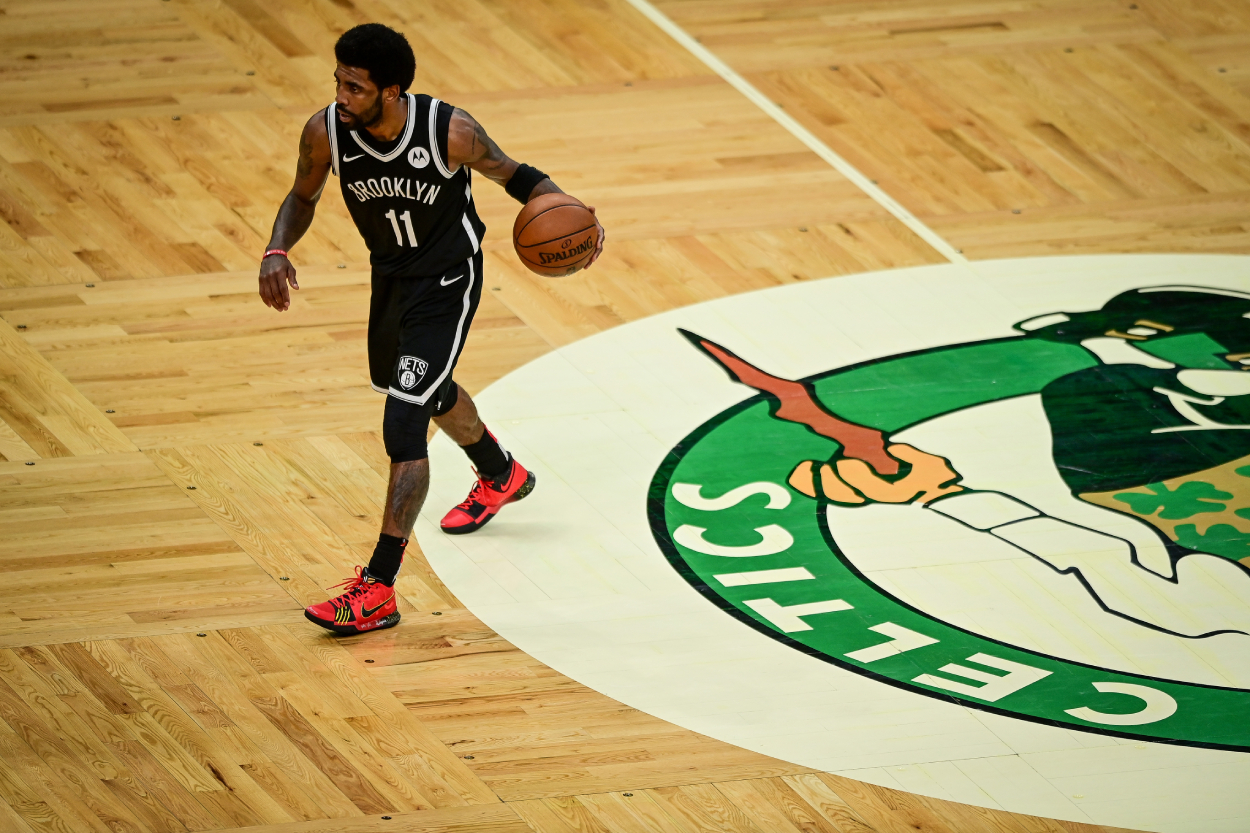 Kyrie Irving Stomps on Celtics Logo After Win, Gets Water Bottle Tossed at Him, and Kevin Durant Goes on Rant