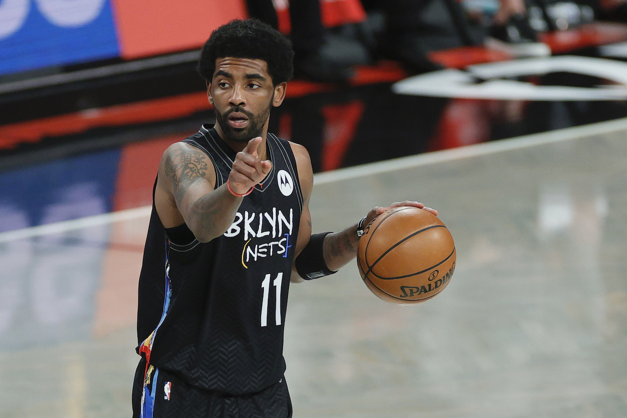 Kyrie Irving of the Brooklyn Nets dribbles ball up court