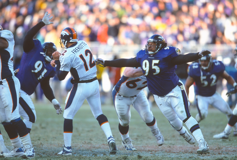 Baltimore Ravens defensive tackle Lional Dalton attempts to tackle Denver Broncos quarterback Gus Frerotte.