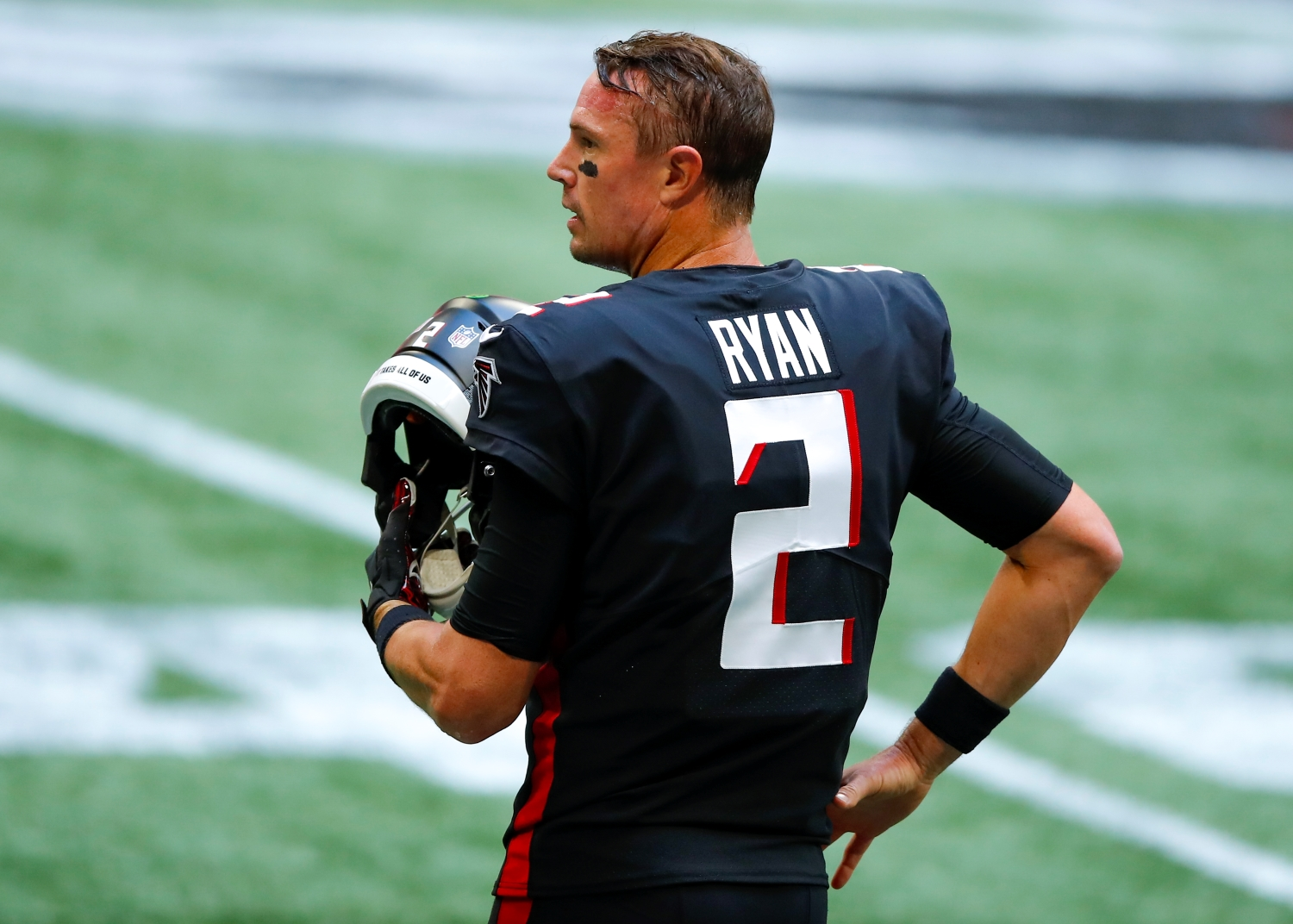 Atlanta Falcons quarterback Matt Ryan stands with his helmet off before a game against the Chicago Bears.