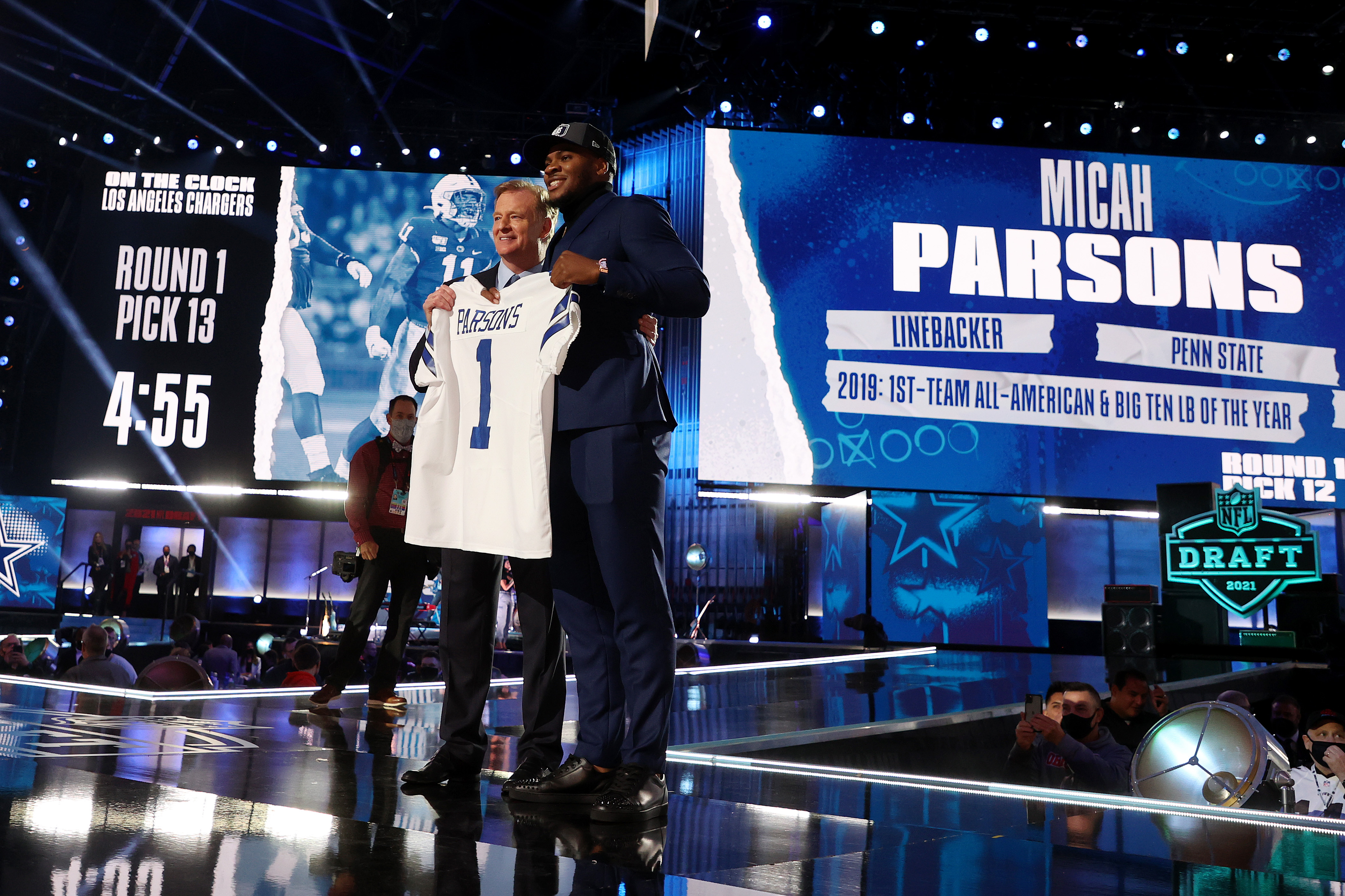 Dallas Cowboy draft pick Micah Parsons poses with NFL Commissioner Roger Goodell onstage during round one of the 2021 NFL Draft at the Great Lakes Science Center on April 29, 2021 in Cleveland, Ohio.
