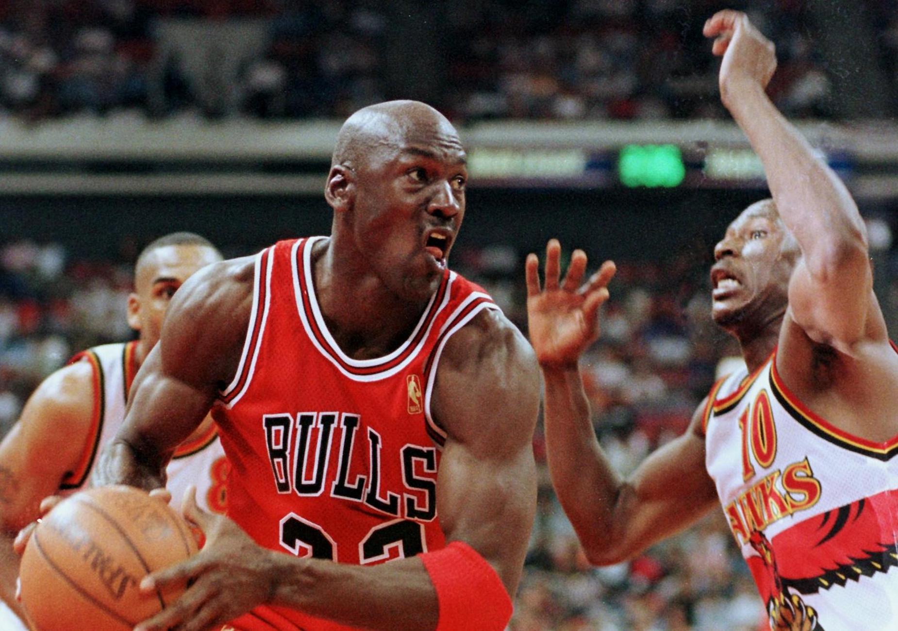 Michael Jordan and Mookie Blaylock during a 1997 NBA playoff game.