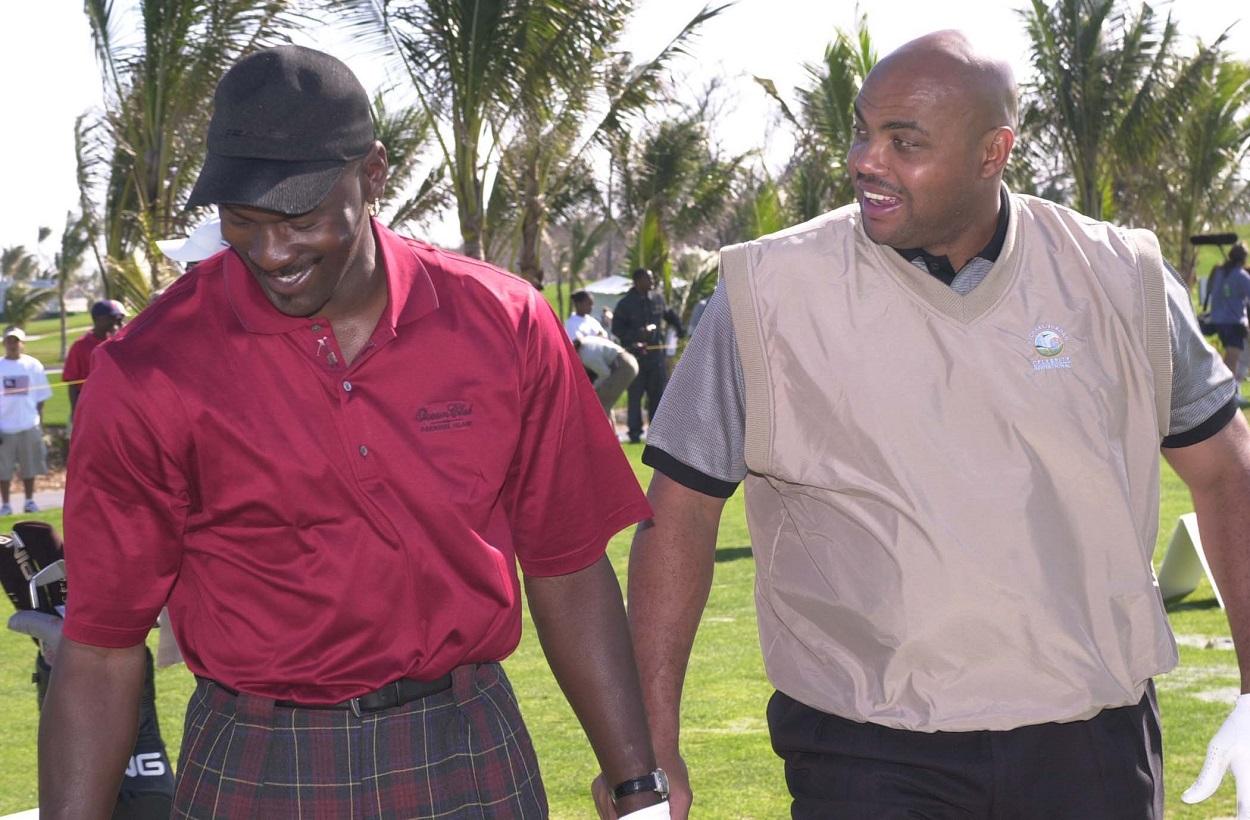 Michael Jordan and Charles Barkley share a laugh during Jordan's celebrity golf tournament