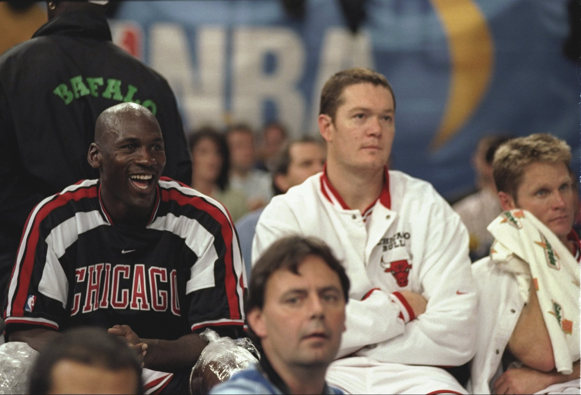Michael Jordan (L) and Luc Longley (R) sit together on the bench as members of the Chicago Bulls.