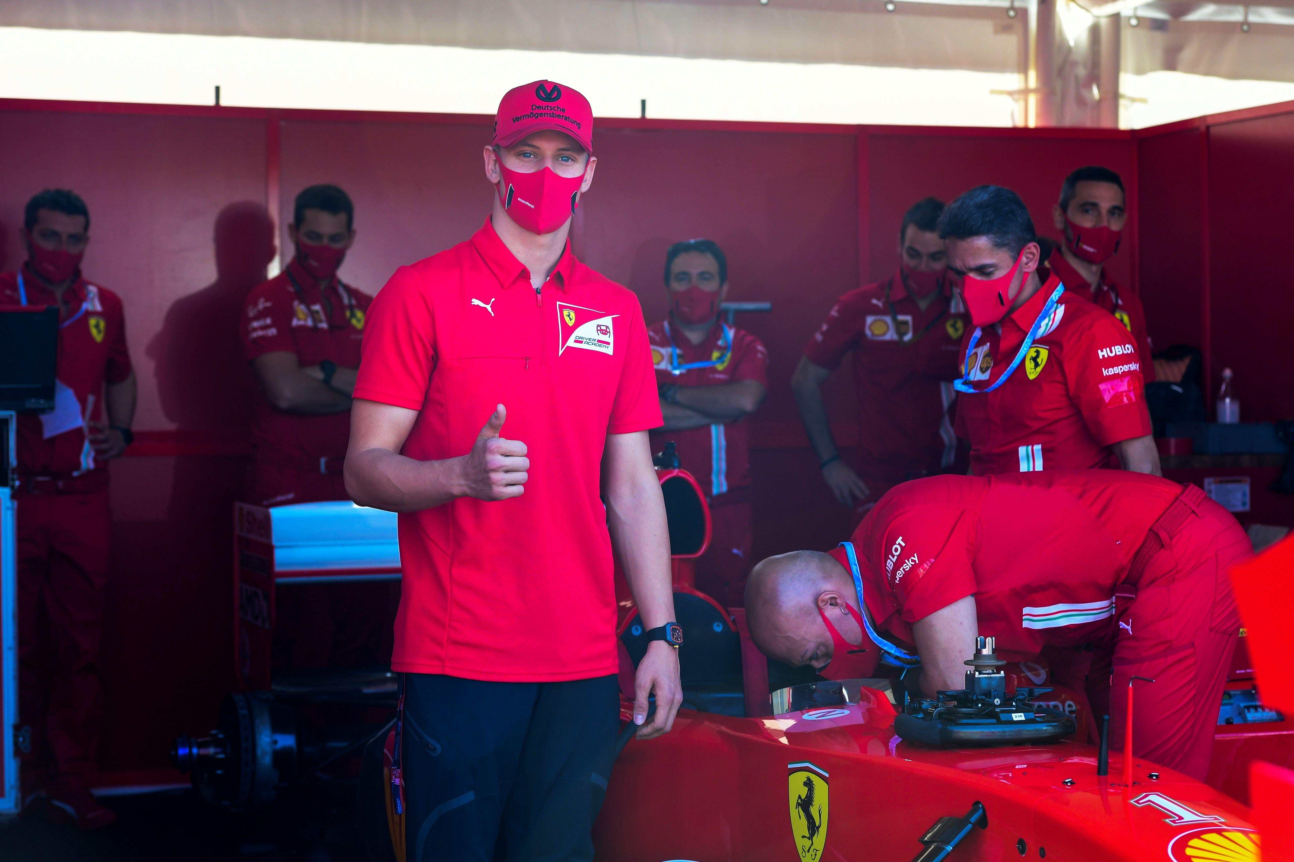 Mick Schumacher, son of former F1 champion Michael Schumacher, visits the Ferrari pit in 2020