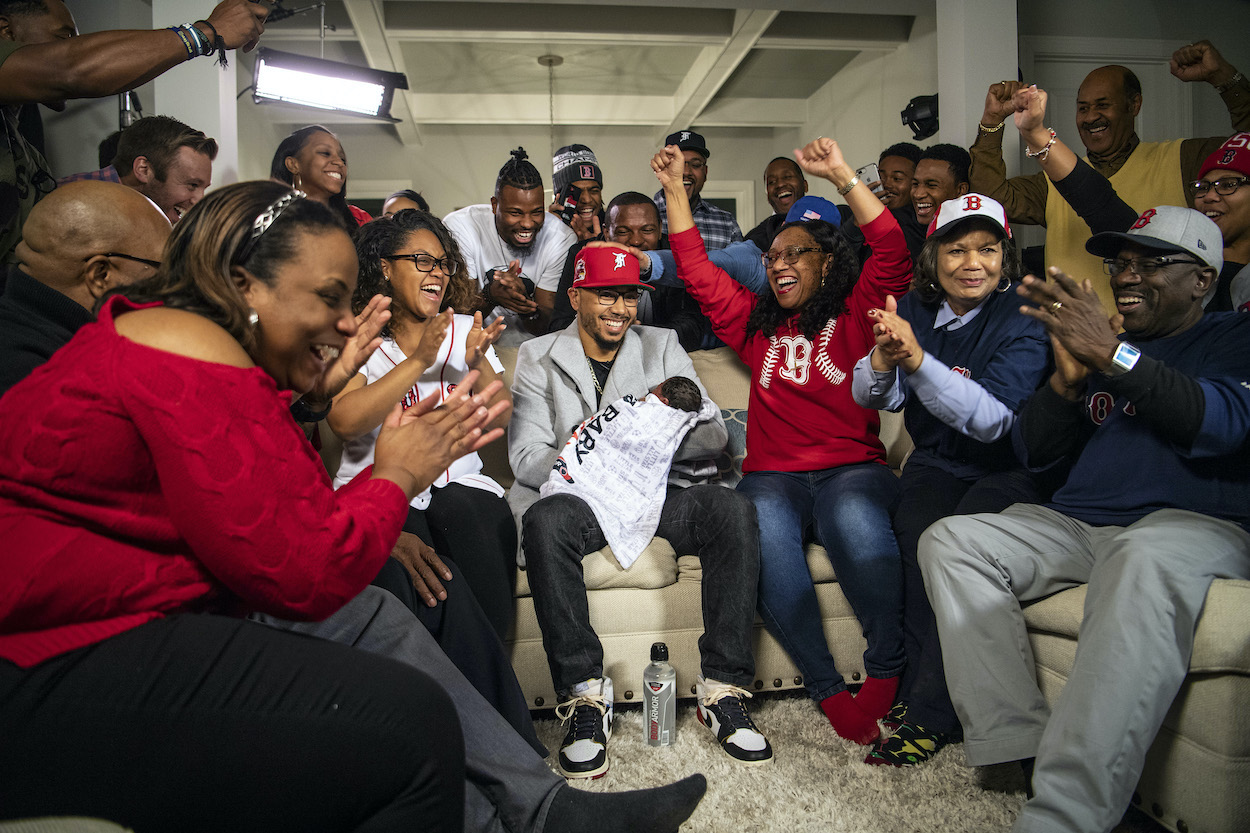 Mookie Betts of the Boston Red Sox reacts with family as he is announced as the 2018 American League MVP