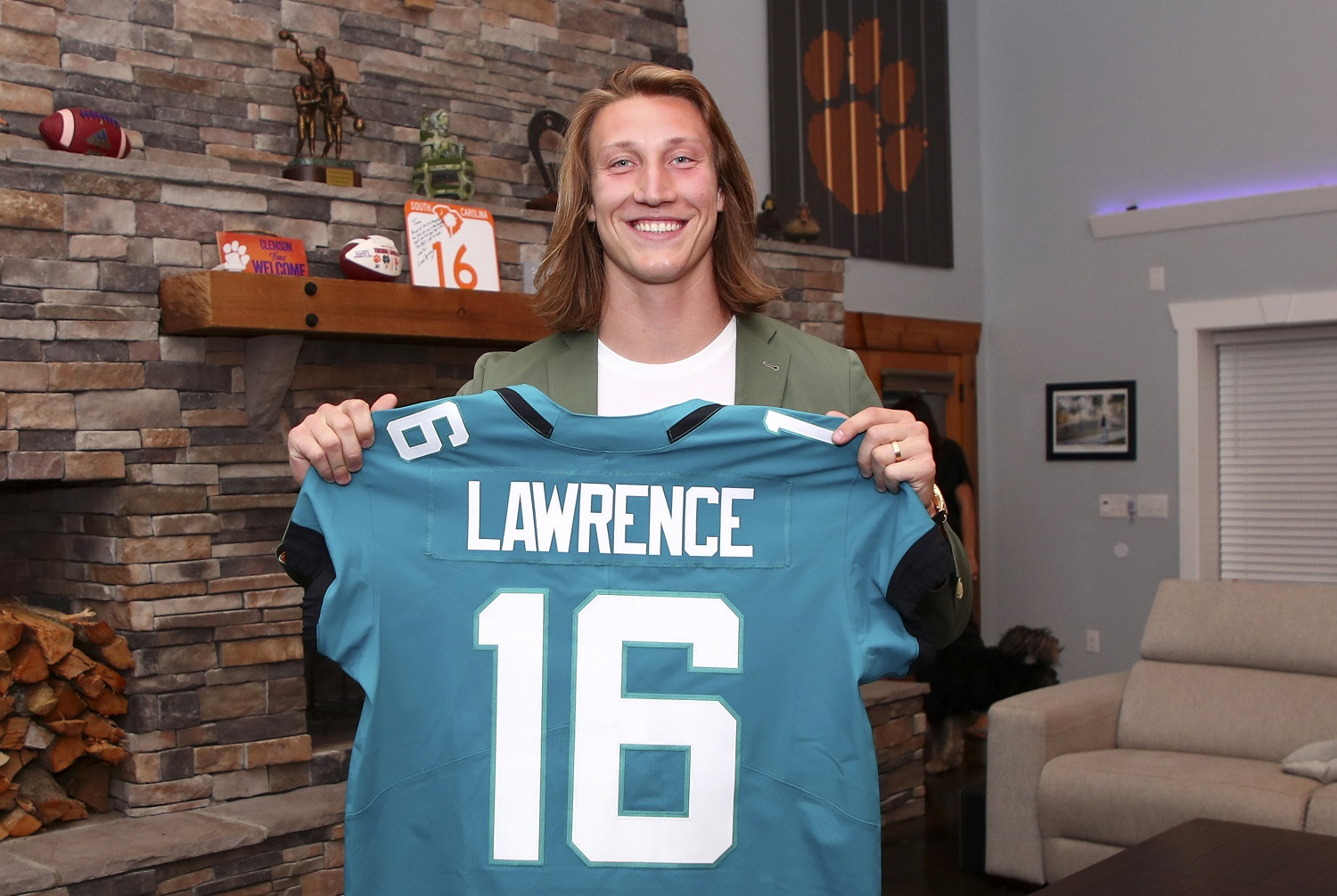 Trevor Lawrence poses after being selected with the first overall pick by the Jacksonville Jaguars in the 2021 NFL Draft.   Logan Bowles/NFL via Getty Images