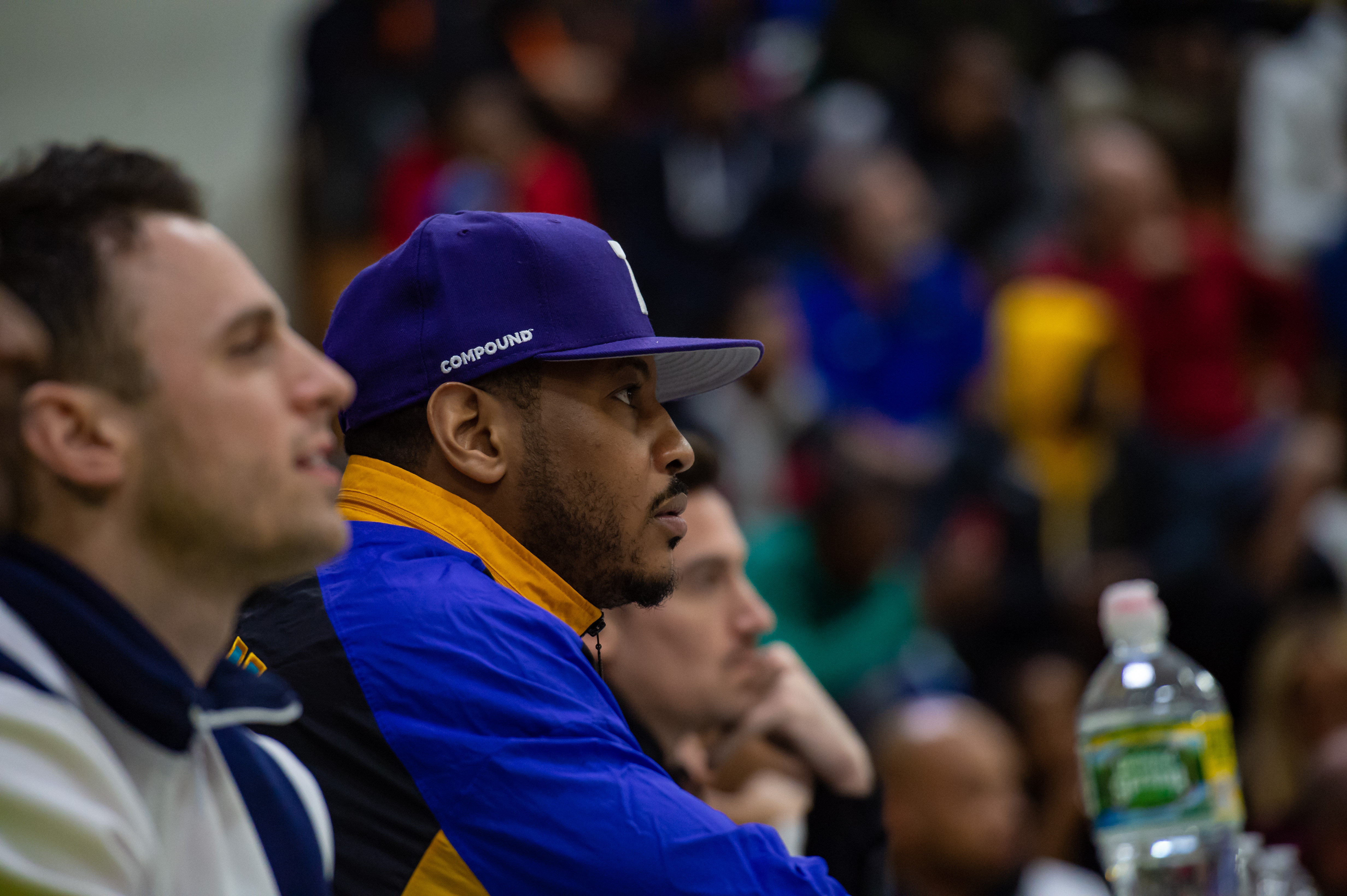 Oak Hill Academy alum Carmelo Anthony takes in the action during an Oak Hill basketball game in 2019