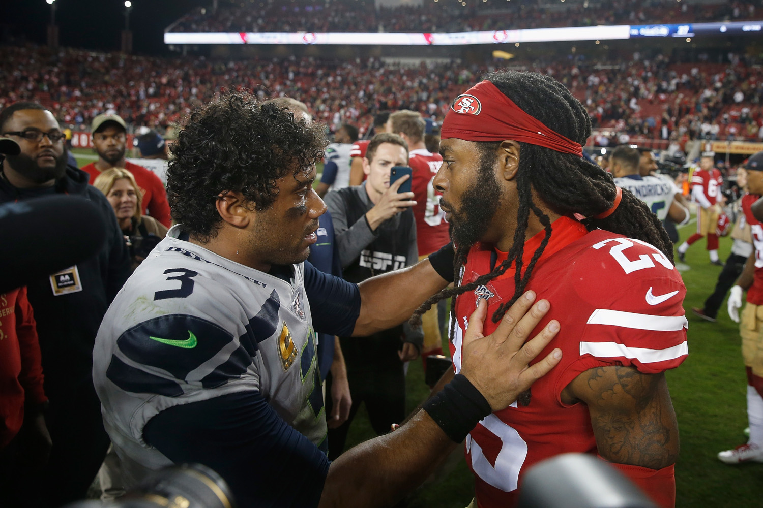 Russell Wilson of the Seattle Seahawks and Richard Sherman of the San Francisco 49ers