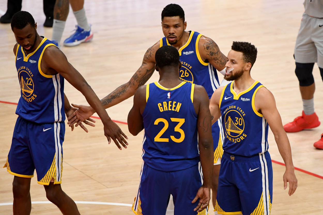 Stephen Curry, Andrew Wiggins, and other Golden State Warriors players in 2021.