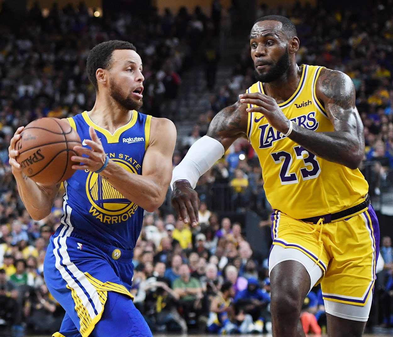 Stephen Curry and LeBron James battle during a Warriors-Lakers matchup in 2018