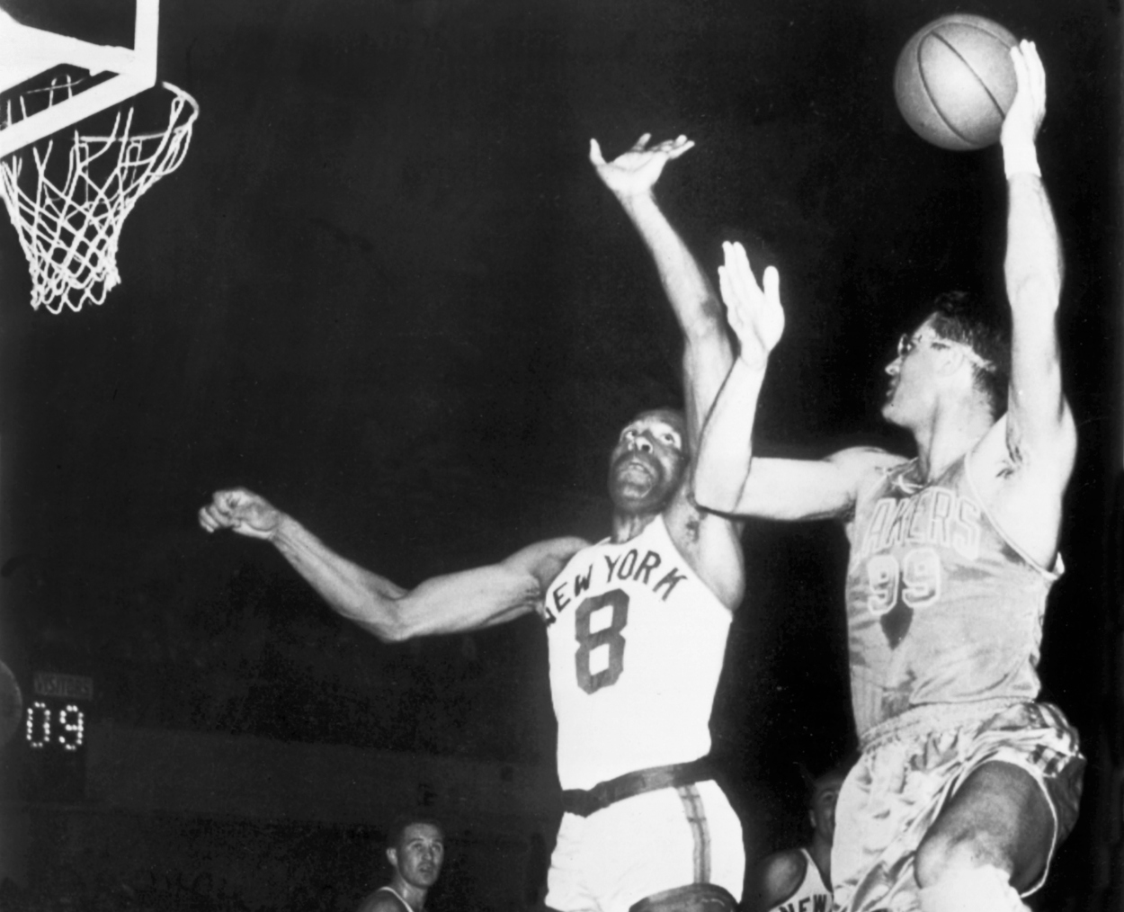 George Mikan (R) and the Minneapolis Lakers dominated the early NBA Playoffs