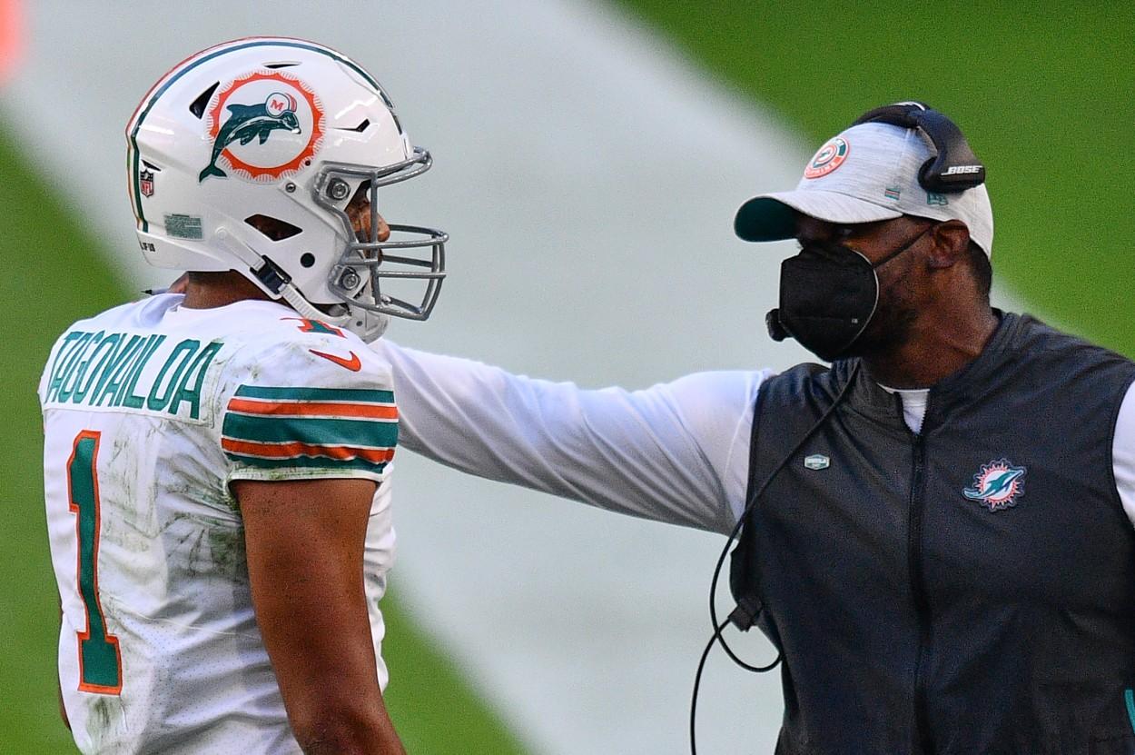 Miami Dolphins quarterback Tua Tagovailoa (L) and head coach Brian Flores in 2020.