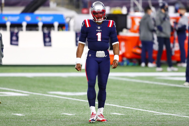Patriots QB Cam Newton walks off the field.
