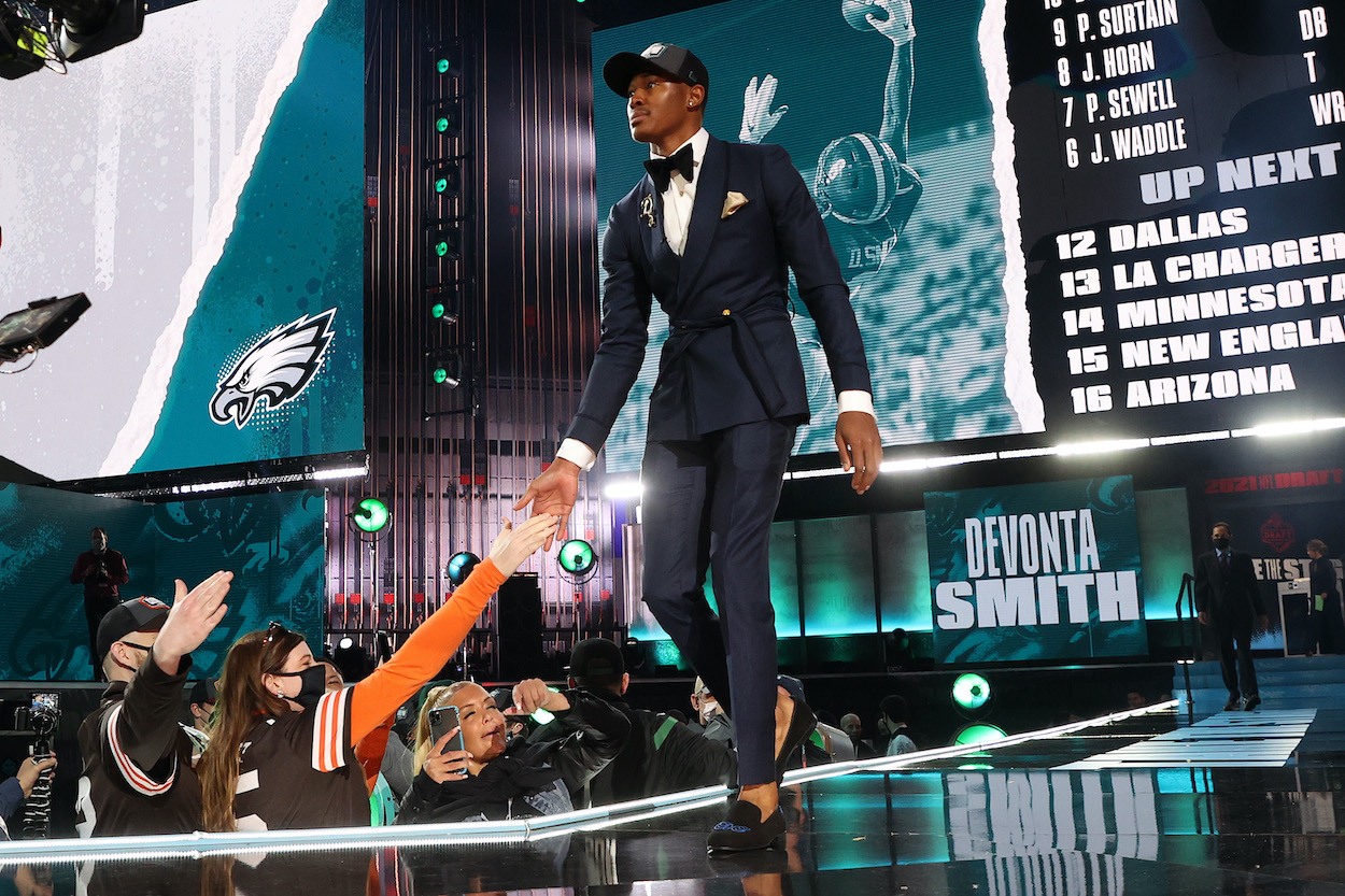 DeVonta Smith walks onstage after being selected 10th by the Philadelphia Eagles during the 2021 NFL Draft