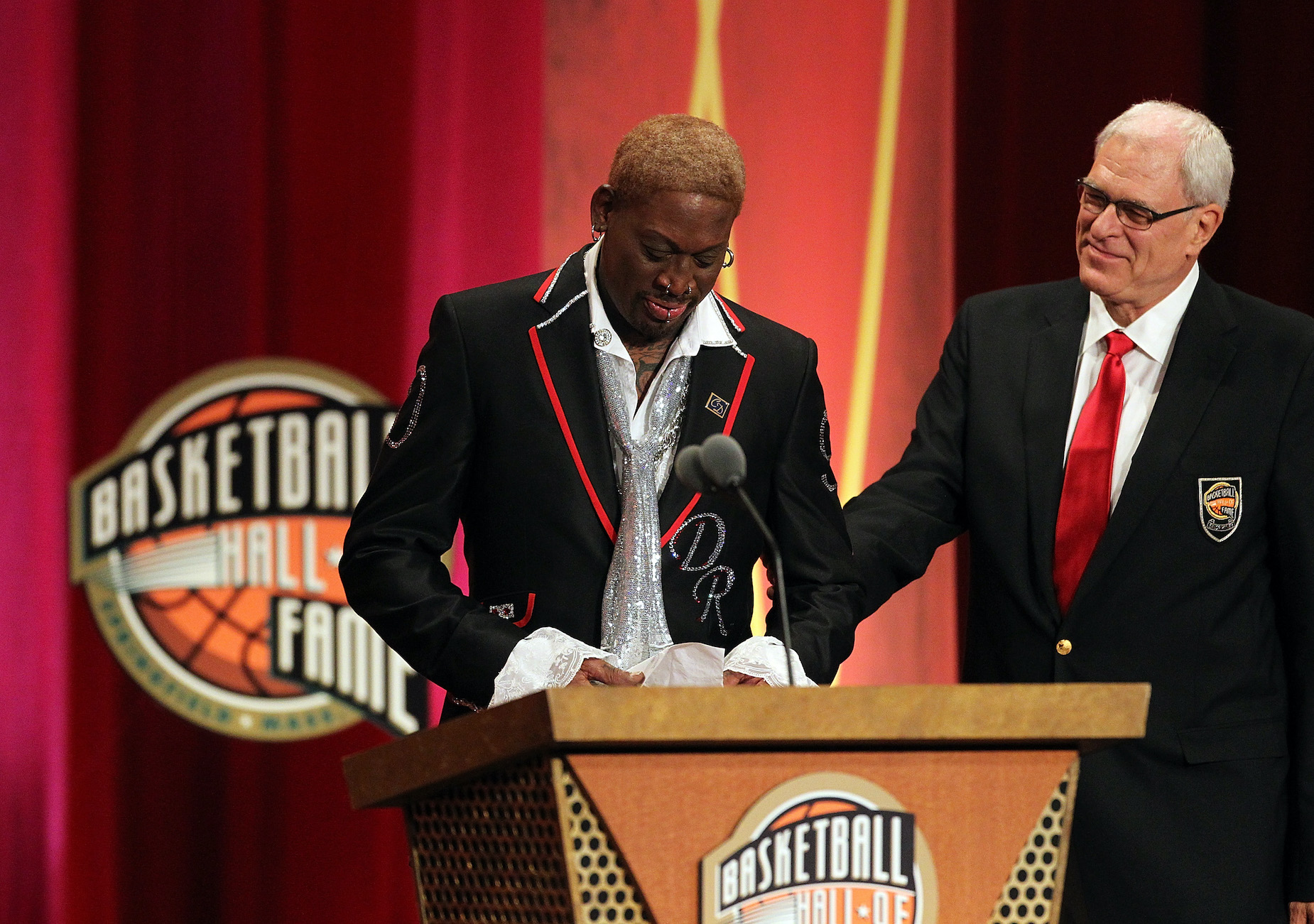 Phil Jackson (R) joins Dennis Rodman on stage during the latter's induction into the Basketball Hall of Fame.