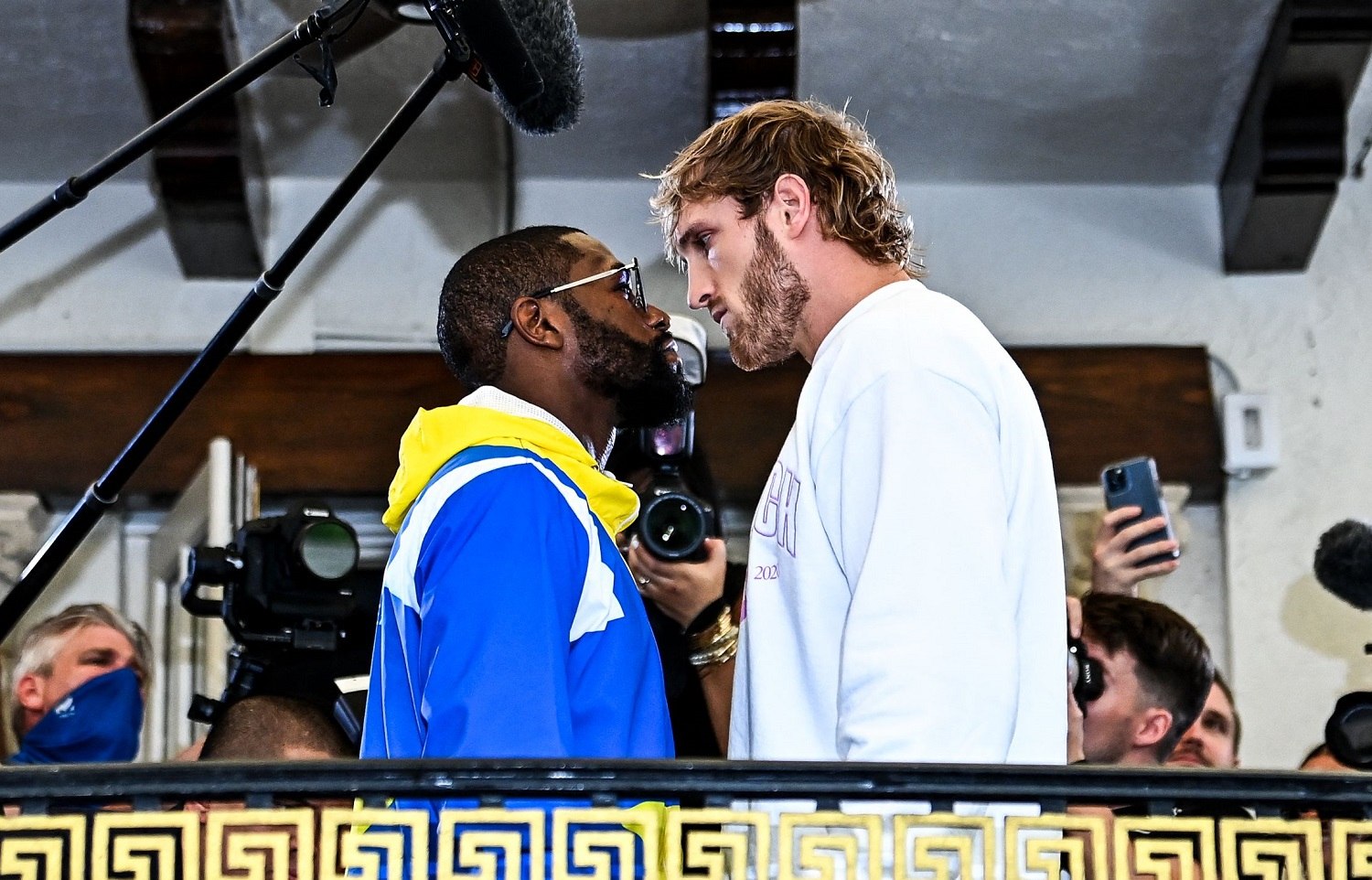 Former world champion Floyd Mayweather and YouTube personality Logan Paul will fight an eight-round exhibition match on June 6.   Chandan Khanna/AFP via Getty Images