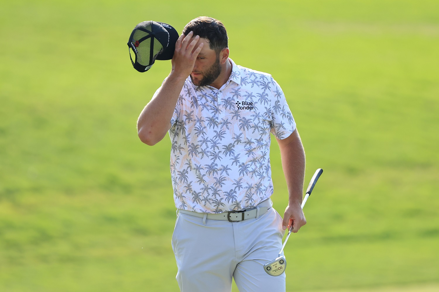 Jon Rahm reacts as he walks off the 18th green after completing his third round of the Memorial Tournament at Muirfield Village Golf Club in Dublin, Ohio. | Photo by Sam Greenwood/Getty Images